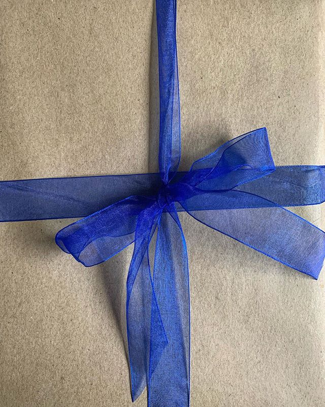 Kraft paper with blue ribbon. Perfection.  #ordershipped #hawkesbury #shippingaustraliawide #hawkesburybusiness #supportsmallbusiness #fathersday #dad #books #gifts