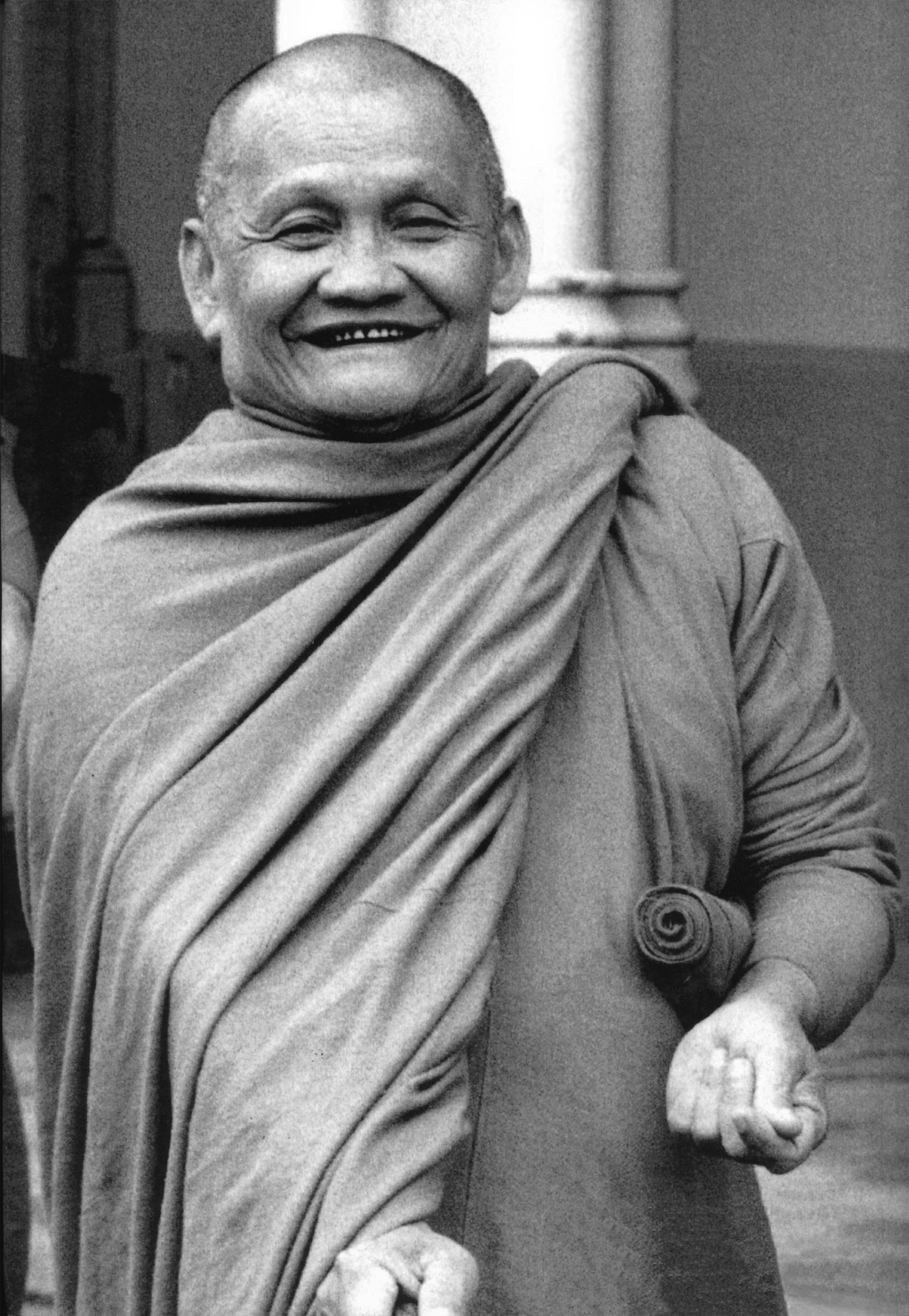 Ajahn Chah - Venerable Ajahn Chah (Phra Bodhiñāna Thera) was born into a typical farming family in a rural village in the province of Ubon Rachathani, N.E. Thailand, on June 17, 1918. At the age of twenty, on April 26, 1939 he entered a monastery for higher ordination as a bhikkhu.In 1946, he set off on mendicant pilgrimage, and studied under the guidance of Venerable Ajahn Mun, the most outstanding Thai forest meditation master of the century. Ajahn Chah practiced in the style of an ascetic monk in the austere Forest Tradition for the next seven years.After many years of travel and practice, he was invited to settle in a thick forest grove near the village of his birth. Ajahn Chah's simple yet profound style of teaching has a special appeal to Westerners, and many have come to study and practice with him. In 1966 the first westerner came to stay at Wat Nong Pah Pong, Venerable Sumedho Bhikkhu. From that time on, the number of foreign people who came to Ajahn Chah began to steadily increase.In 1977, Ajahn Chah and Ajahn Sumedho were invited to visit Britain by the English Sangha Trust, a charity with the aim of establishing a locally-resident Buddhist Sangha. Seeing the serious interest there, Ajahn Chah left Ajahn Sumedho (with two of his other Western disciples who were then visiting Europe) in London at the Hampstead Vihara. He returned to Britain in 1979, at which time the monks were leaving London to begin Chithurst Buddhist Monastery in Sussex. He then went on to America and Canada to visit and teach.Although Ajahn Chah passed away in 1992, the training which he established is still carried on at Wat Nong Pah Pong and its branch monasteries, of which there are currently more than two hundred in Thailand.Wisdom is a way of living and being, and Ajahn Chah has endeavored to preserve the simple monastic life-style in order that people may study and practice the Dhamma in the present day.