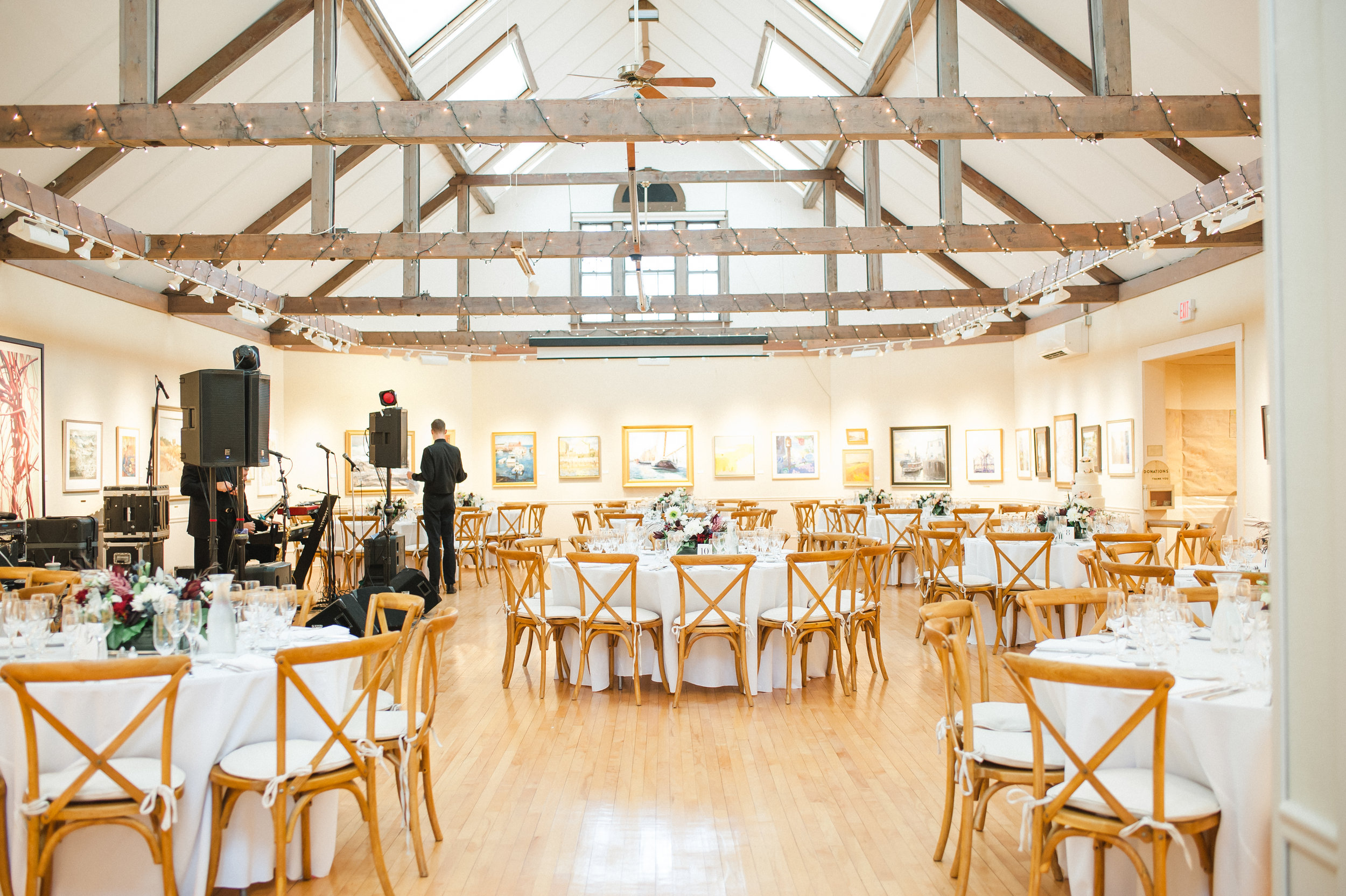 Our spacious Hibbard Gallery can seat up to 125 guests for a sit-down dinner and can accommodate up to 180 guests for a tapas/cocktail style event. Fine art enhances an elegant table setting. Image courtesy of  Esther Mathieu Photography