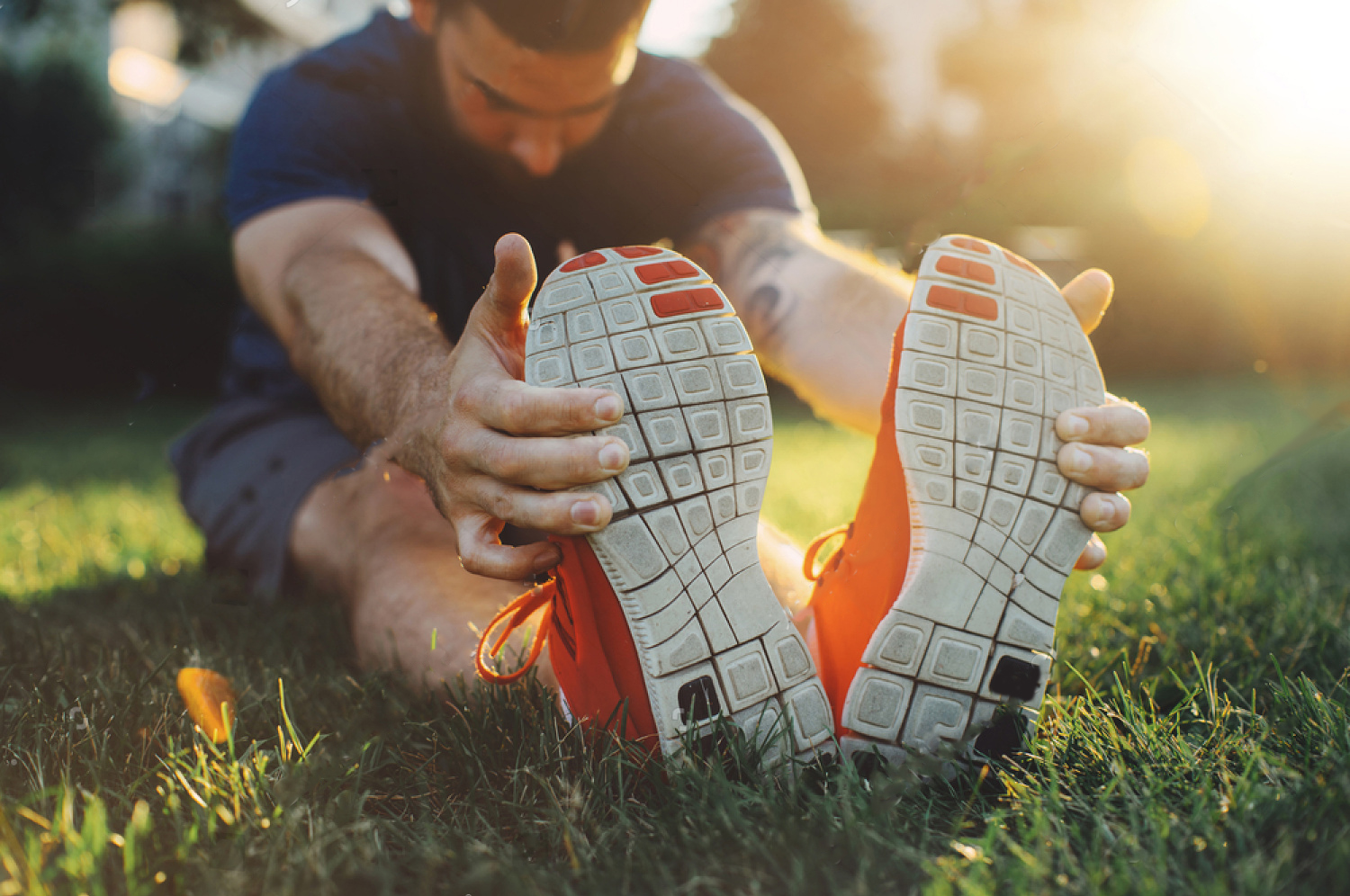 stock-photo-attractive-young-man-stretching-in-the-park-before-running-at-the-sunset-focus-on-shoes-684709789 copy.jpg
