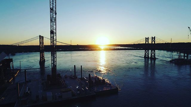 Bridge sunset! #quadcities #davenportiowa #bettendorf #iowa #illinois #bridge #construction #sunset #blue #mississippi #river #bodiesofwater #beauty #midwest #drones #aerialphotography #sunset