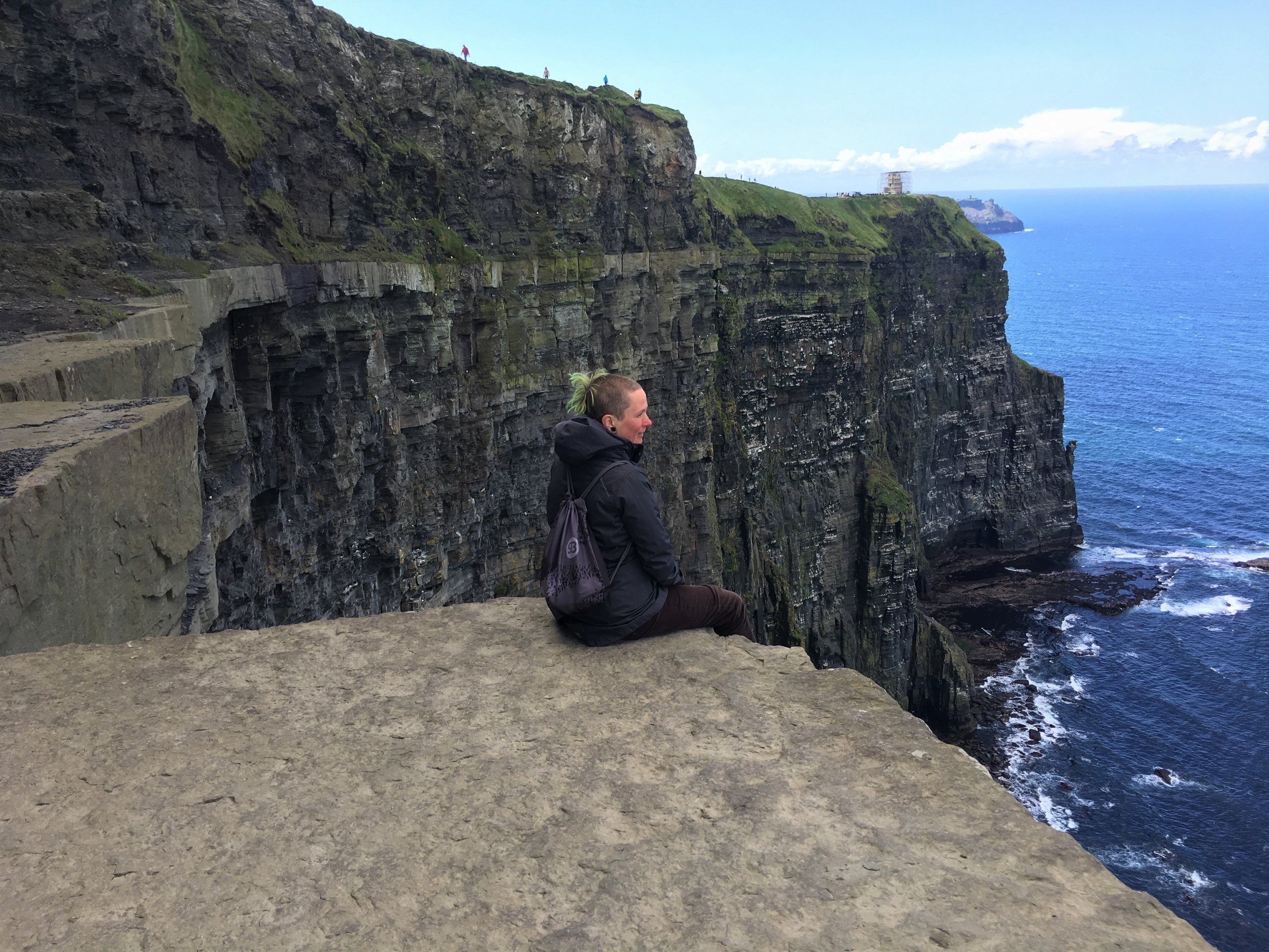 Here's me, fucking terrified sitting on this edge at the Cliffs of Moher in Ireland. This was no fakey ledge either. It was a legit, straight drop down far...really, really.. really  far. Those white patches on the cliff-side behind me are hundreds (yes, hundreds) of seagulls. Buying the Nord was about as scary as this.