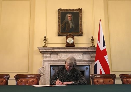 Theresa May writing the letter that triggered Article 50 in March 2017. An image that came to be parodied on levels not seen since Spitting Image.