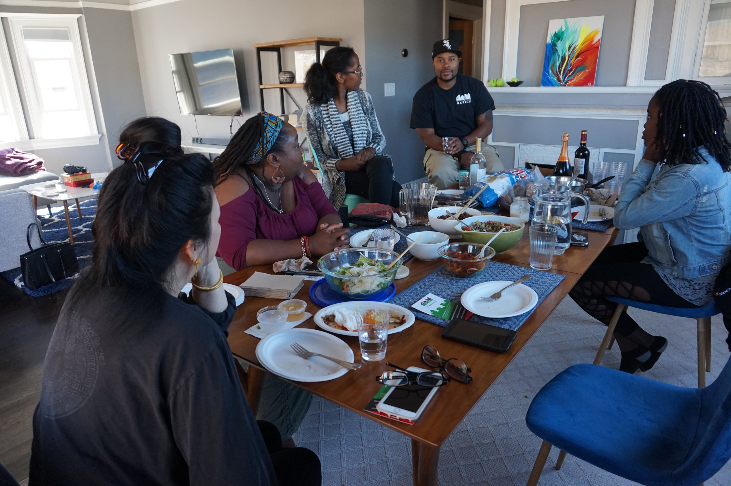 A group discussing family practices of honoring ancestors.