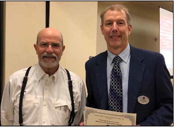 Past president    Charles Adams, MD   , (left) recognizes program chair and president    Eric Born, DO   , for an outstanding meeting
