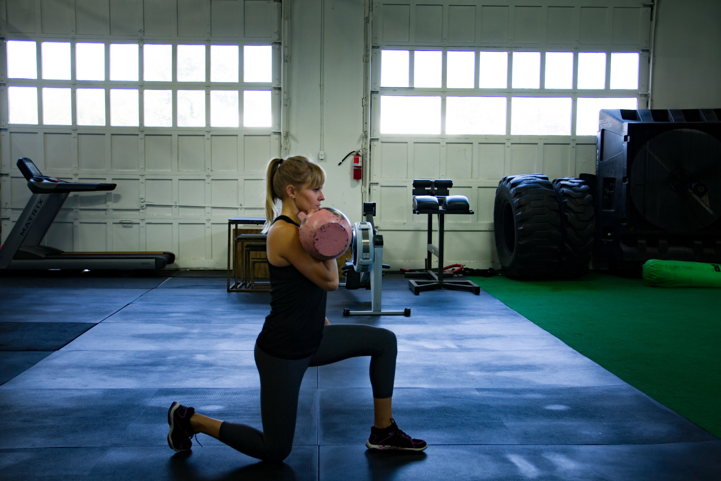 Kate Half Kneeling KB Rack.jpg