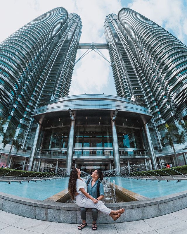 Who knows where we are?! 🇲🇾 We've actually been here for 3 weeks! 🤭 We weren't expecting to come to this city but sometimes plans change. Actually, plans change a lot as a digital nomad. If your a planner like me, then change and a lack of routine can be frustrating. But if we've learned anything from traveling, it's important to plan a little less, let go of a little control, and expect very little. Don't force things that don't feel right or are straight up not going to work. Don't resist the inevitable. Follow these pieces of advice digital nomads and we promise your life will be a little less stressful. 💙 * * * * * #coupletravelgoals #creativetravelcouples #couplestravelgoals #travelcouplesinspiration #inspiredtravelcouples #travelcouplelife #travelcouplecollective #travelcouplecommunity #travelcouplesgoals  #travelblog #travelblogger #travelbloggers #travelbloggerspt #travelbloggerlifestyle #Travelblogging #coupletravelblog  #digitalnomad #digitalnomads #digitalnomadlifestyle #digitalnomadcouple #digitalnomadism #digitalnomadslife #digitalnomadblog #digitalnomadbusiness #digitalnomadcouples #malaysia #petronastowers #travelmalaysia