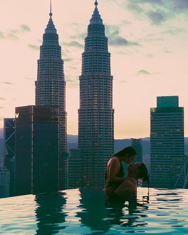 Can't believe we're still on this crazy journey together. Still don't know what city this is?! We were in Kuala Lumpur, Malaysia 🇲🇾 and we absolutely loved it. ❤️ Our favorite night was a romantic visit to this incredible infinity food overlooking the iconic Petronas Towers. Definitely one for the books 📚 . . . . . . . #coupletravelgoals #creativetravelcouples #couplestravelgoals #travelcouplesinpiration #inspiredtravelcouples #travelcouplelife #travelcouplecollective #travelcouplescommunity #travelcouplesgoals #travelmalaysia #malaysia #kualalumpur #kualalumpurcity #petronastowers #travelblog #travelblogger #travelbloggers #digitalnomad #digitalnomads #coupletravelblog #infinitypool #infinitypoolview #digitalnomads #digitalnomadlifestyle #digitalnomadcouple #digitalnomadism #digitalnomadlife #digitalnomadcouples