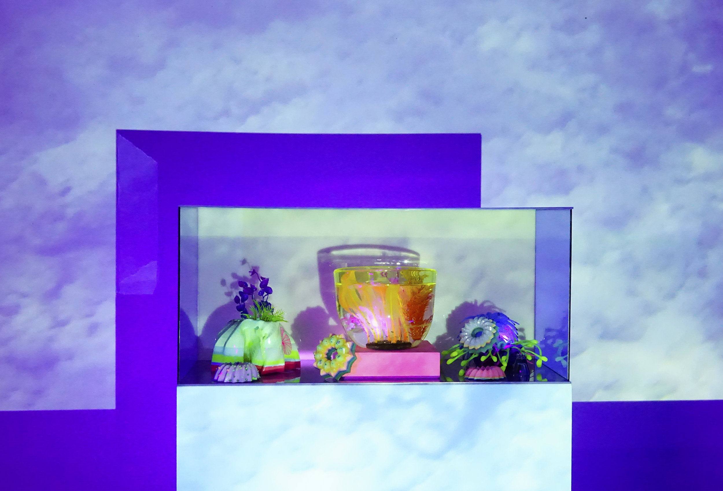 'Night Dive,' 2019. Video and Ultrasound projection, UV‐reactive paint, wood pedestals, uranium glass, UV‐reactive flock, HD projector, HSS speaker, plexiglass, and LED UV light, dimensions variable.