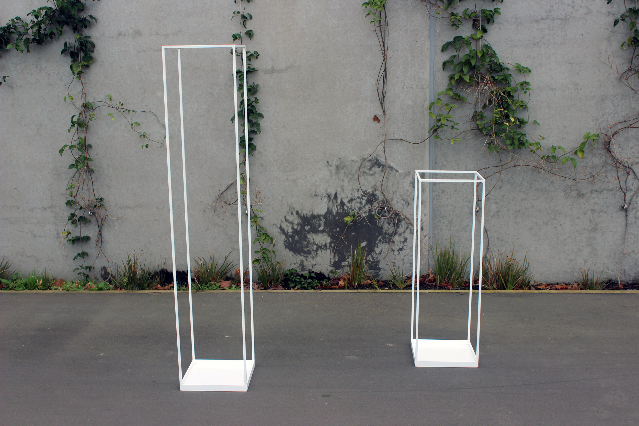 Steel Floral Stands - White - Sizes:90cm tall x 30cm x 30cm1.5m tall x 30cm x 30cmPOA