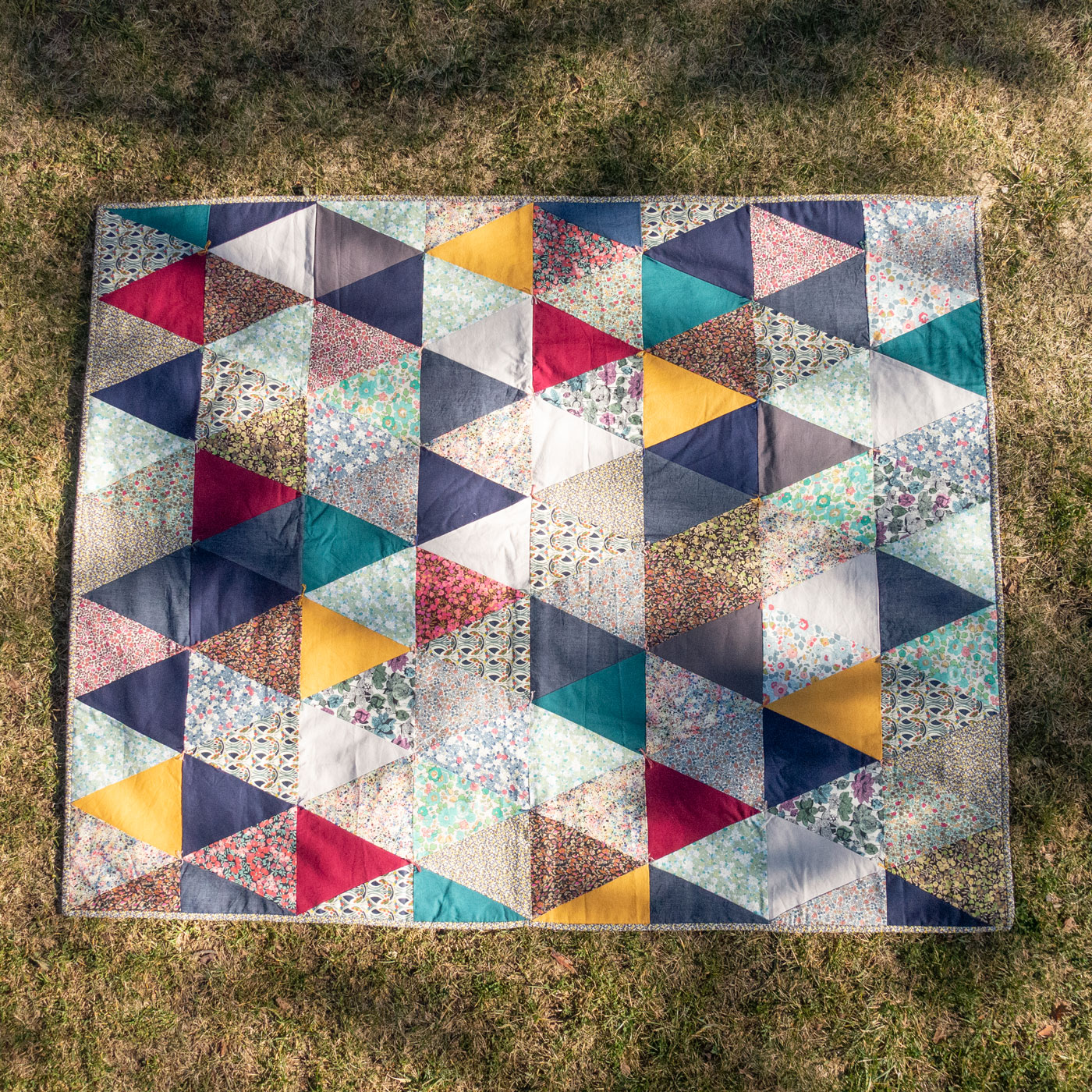 Quilty - This guy is a great little quilt for popping over your knees to keep warm. Lined with wool batting and decorated with vintage fabrics it looks at home in any situation. This is a personal favourite of mine!