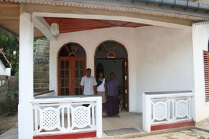 Milton's family outside their new home in Unawatuna