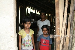 Sumanawathie and her daughters in their old house
