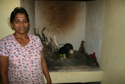 Nilmi looking happy in her new kitchen