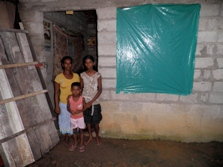 Anuthara with her family outside their home