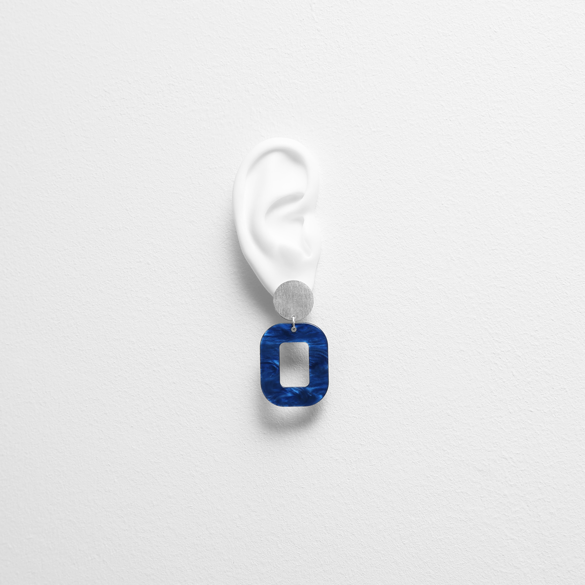 deep-blue-baby-rosa-earrings-try-on.png