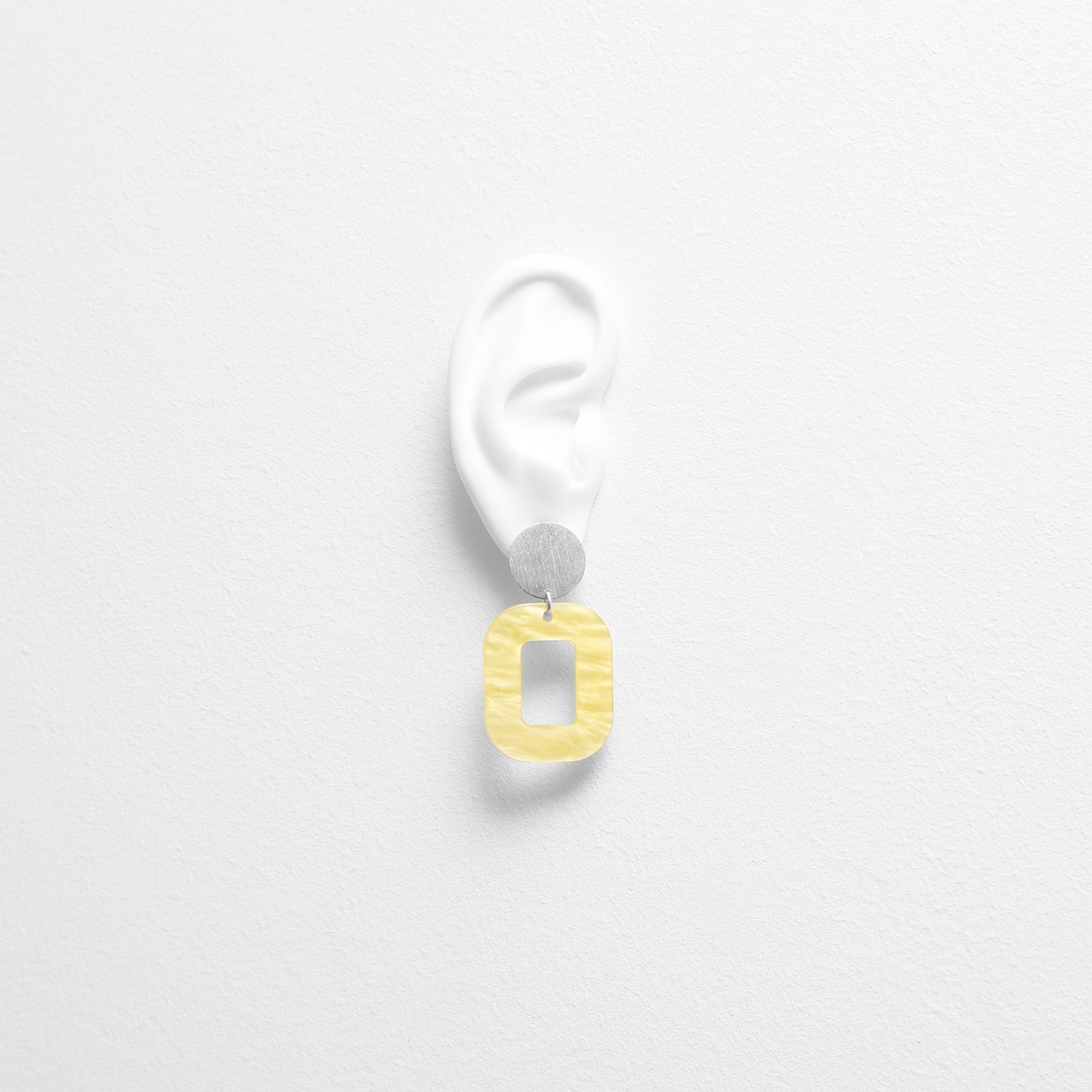 pastel-yellow-baby-rosa-earrings-try-on.png