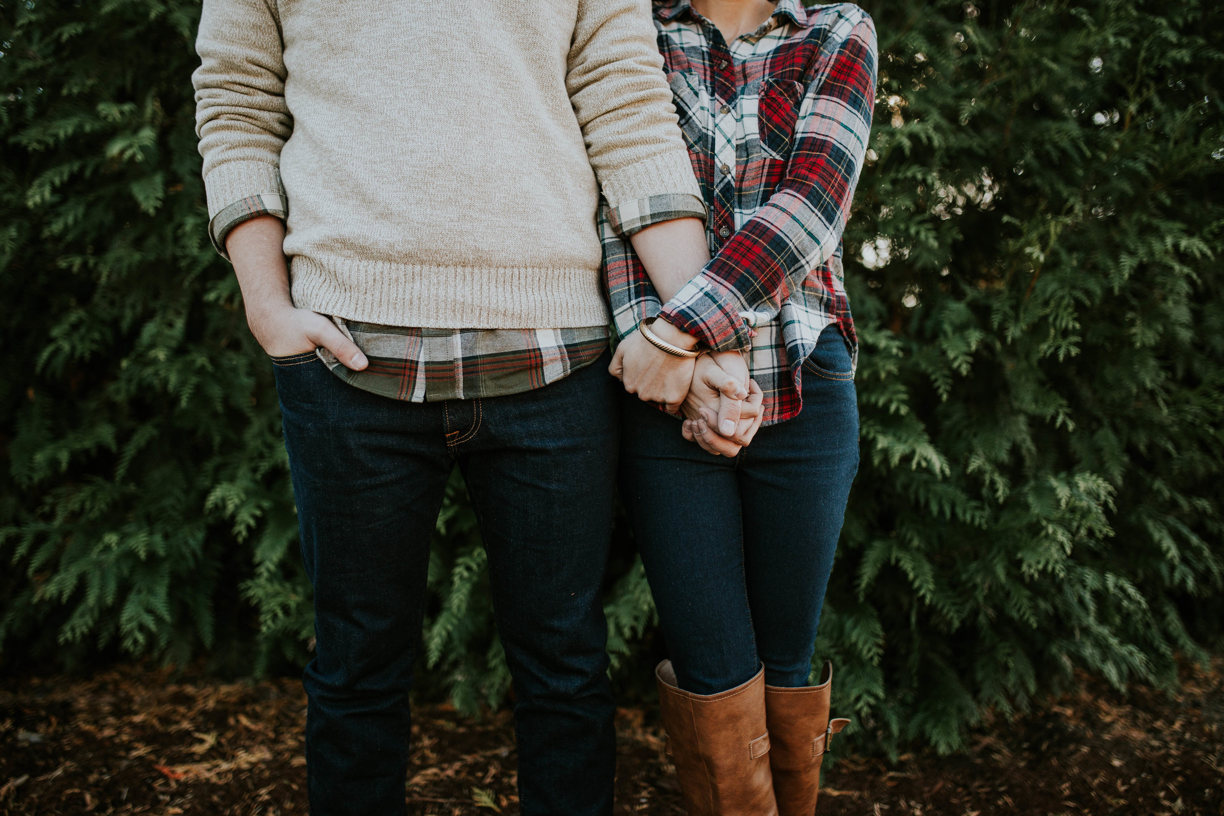 young couple holding hands expectantly