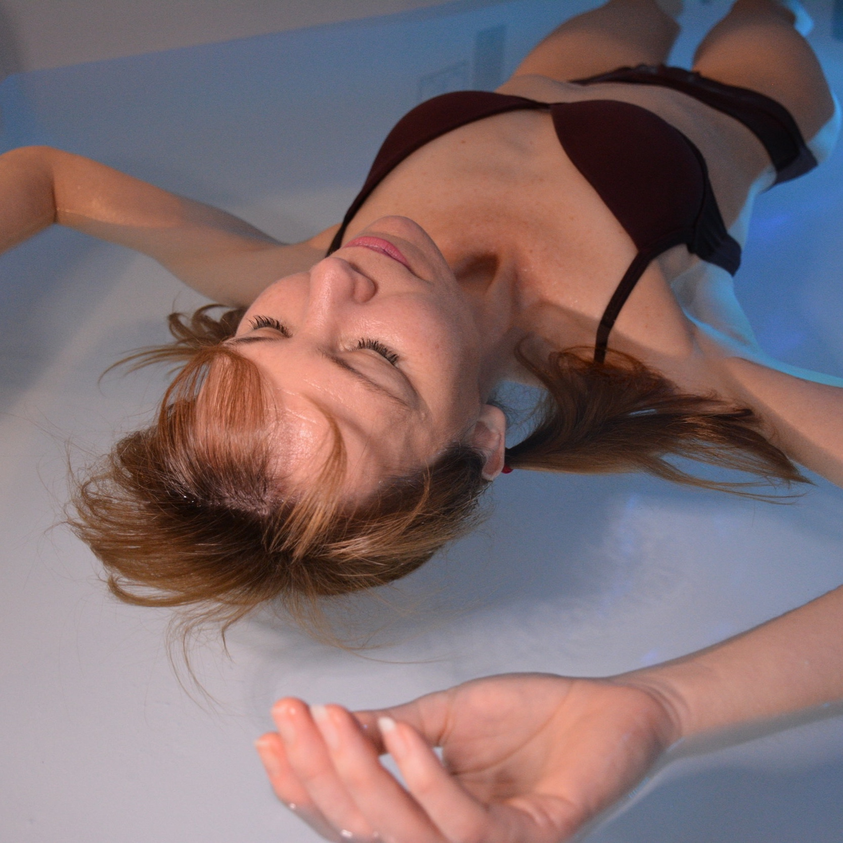 """Floatation Therapy - """"Floating"""" or """"Float Therapy"""", as referred to by some, is the activity involving either an enclosed private room or pod filled with approximately 10-12 inches of warm (94'F) water and 1100 lbs of epsom salt and magnesium solution. The high buoyancy levels achieved allow for an apparently gravity-free environment as you effortlessly drift away into complete and total renewal of the mind, body and spirit. Formally recognized as sensory deprivation, floatation therapy more precisely involves diminishing external stimuli typically found intrusive in one's life and ultimately strengthening self-awareness, supporting mindfulness practices and enhancing internal stimuli. Floating is an exclusive practice with unique physical, mental and spiritual gains that network to generate long lasting results that compound over time with routine and regular use."""