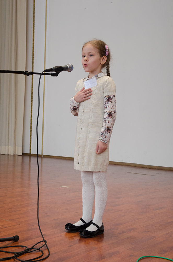 "(6–8) Renata Skvortsova recited E. Moshkovskaya's poem ""Morning and Evening"" in her room, near her doll house and stuffed toy animals on the video."