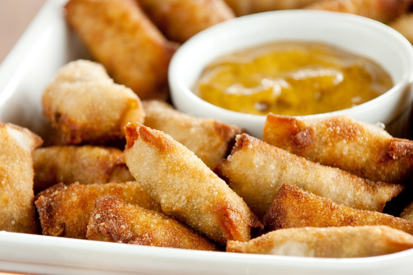 Mallard Spring Rolls. - Makes 96 rolls.½ pound ground duck breasts½ pound ground pork1 bunch scallions, chopped fine4 carrots, peeled and finely grated5 – 6 Napa cabbage leaves, chopped2 teaspoons ground ginger½ cup soy sauce2 packages won ton wrappersSmall dish of waterPeanut oil for fryingCombine all ingredients. I use my hands to mix ingredients well. Cover and refrigerate several hours or overnight.TO MAKE ROLLS: Place a teaspoon of filling diagonally just below center of wrapper. Roll up starting with the corner below filling and folding in each side corner before rolling up. Be sure to seal edges by dipping your index finger in water and smearing it along the edges of the wrapper before pressing the edges closed so the filling does not escape during frying.Fry in peanut oil heated to 350 degrees F for 5 minutes or until golden and no longer pink inside.Serve with Honey Mustard Dipping Sauce or purchased Chinese mustard.HONEY MUSTARD DIPPING SAUCE:½ cup Gulden's spicy brown mustard3 – 4 tablespoons honeyMix the above in a small bowl. Add additional honey, if desired.