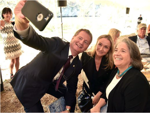 Knox County Mayor Tim Burchett, left, takes a selfie with Alexandra Cousteau, center, and Knoxville Mayor Madeline Rogero at the Legacy Parks' annual luncheon at the Seven Islands State Birding Park on Friday, Oct. 13, 2017. Alexandra Cousteau, award-winning filmmaker, National Geographic Explorer and global water advocate, was the featured speaker at the event.(Photo: J. Miles Cary / Special to the News Sentinel)