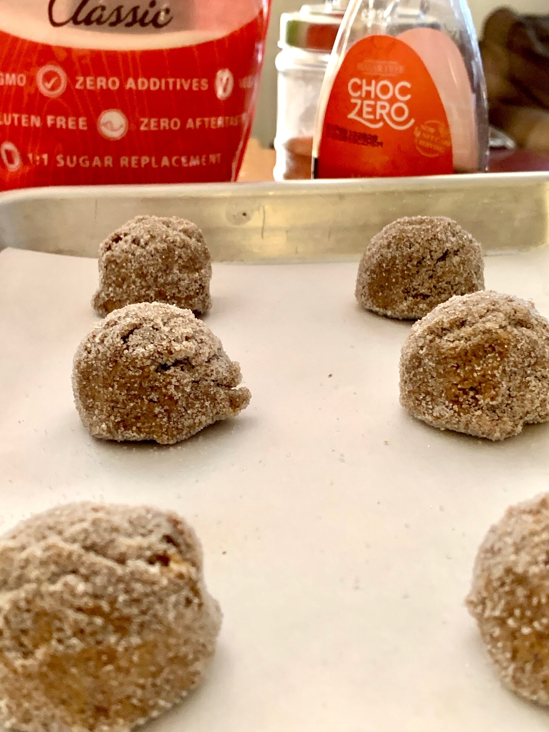 Roll each cookie dough ball in sweetener to completely coat for crispy crunch!