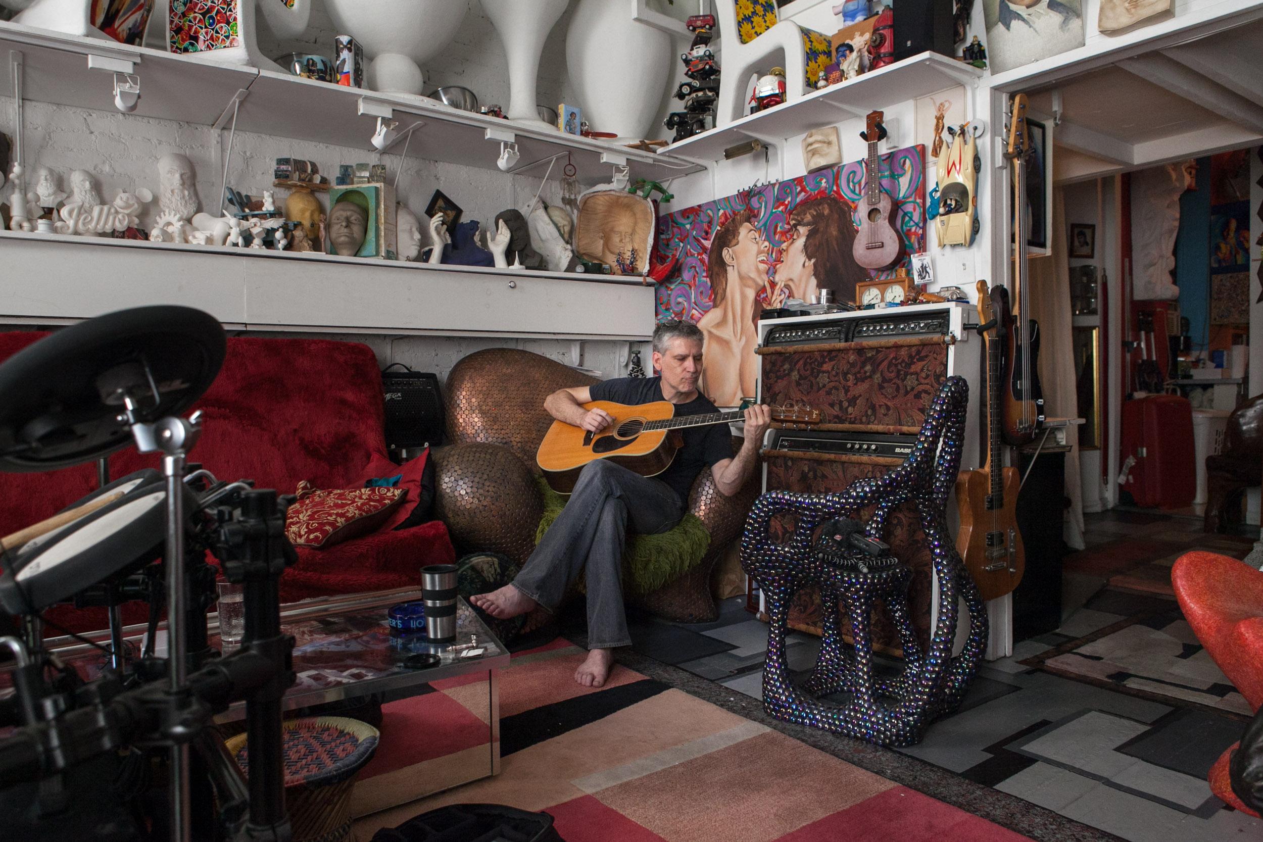 Michael Ferrari-Fontana in his St. Marks Place home. [Emon Hassan/Guitarkadia]