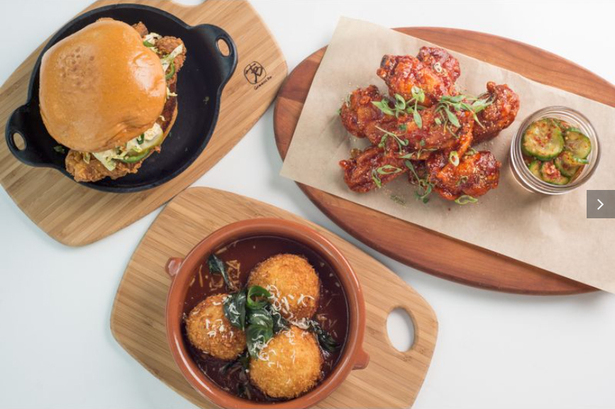 The fried chicken sandwich, chicken wings and arancini balls from Magnolia House, now open in Pasadena. (Magnolia House)