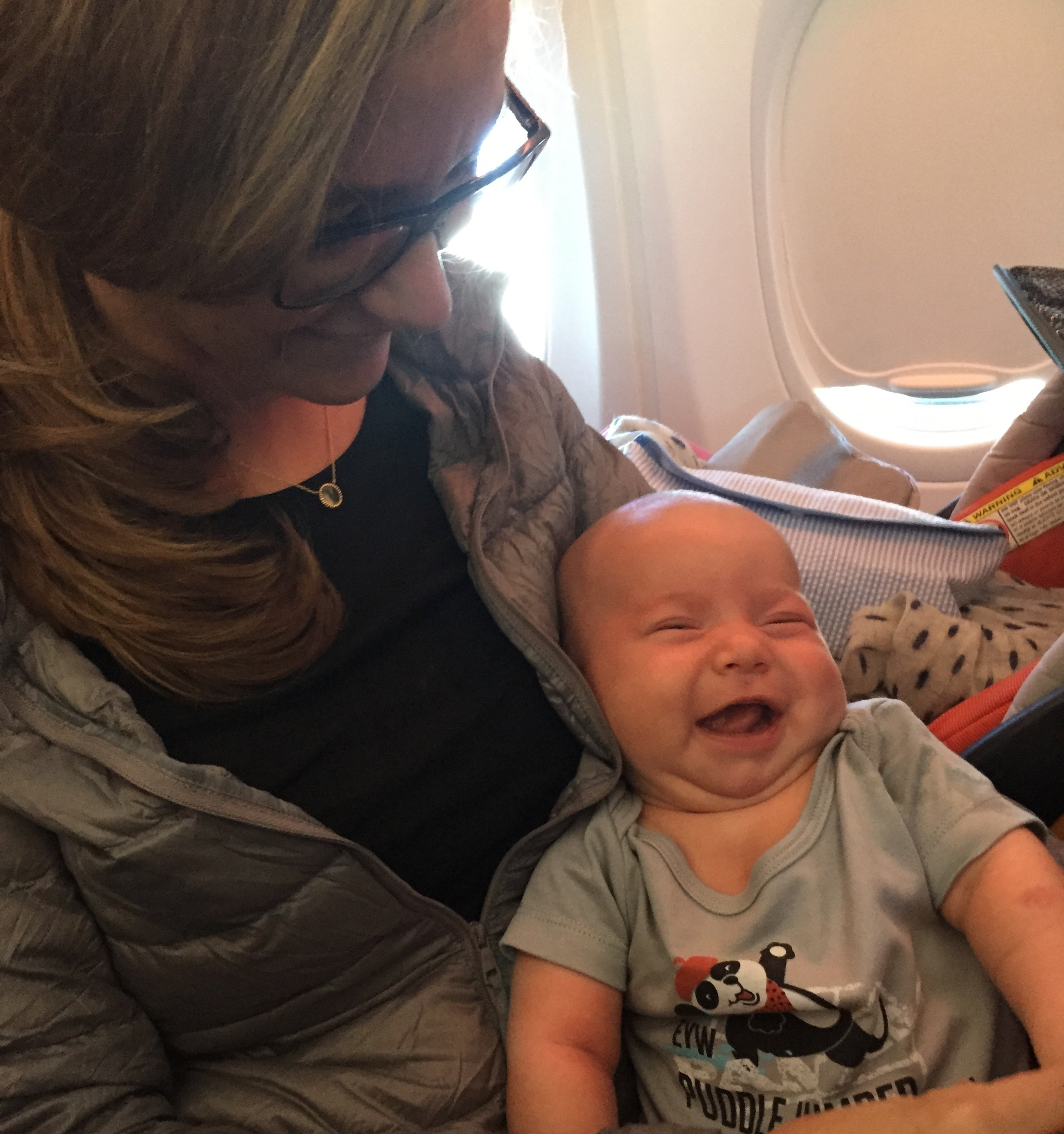 Thomas's first flight to San Fran. We had to change that vintage Pan Am onsie as soon as the seatbelt light turned off.