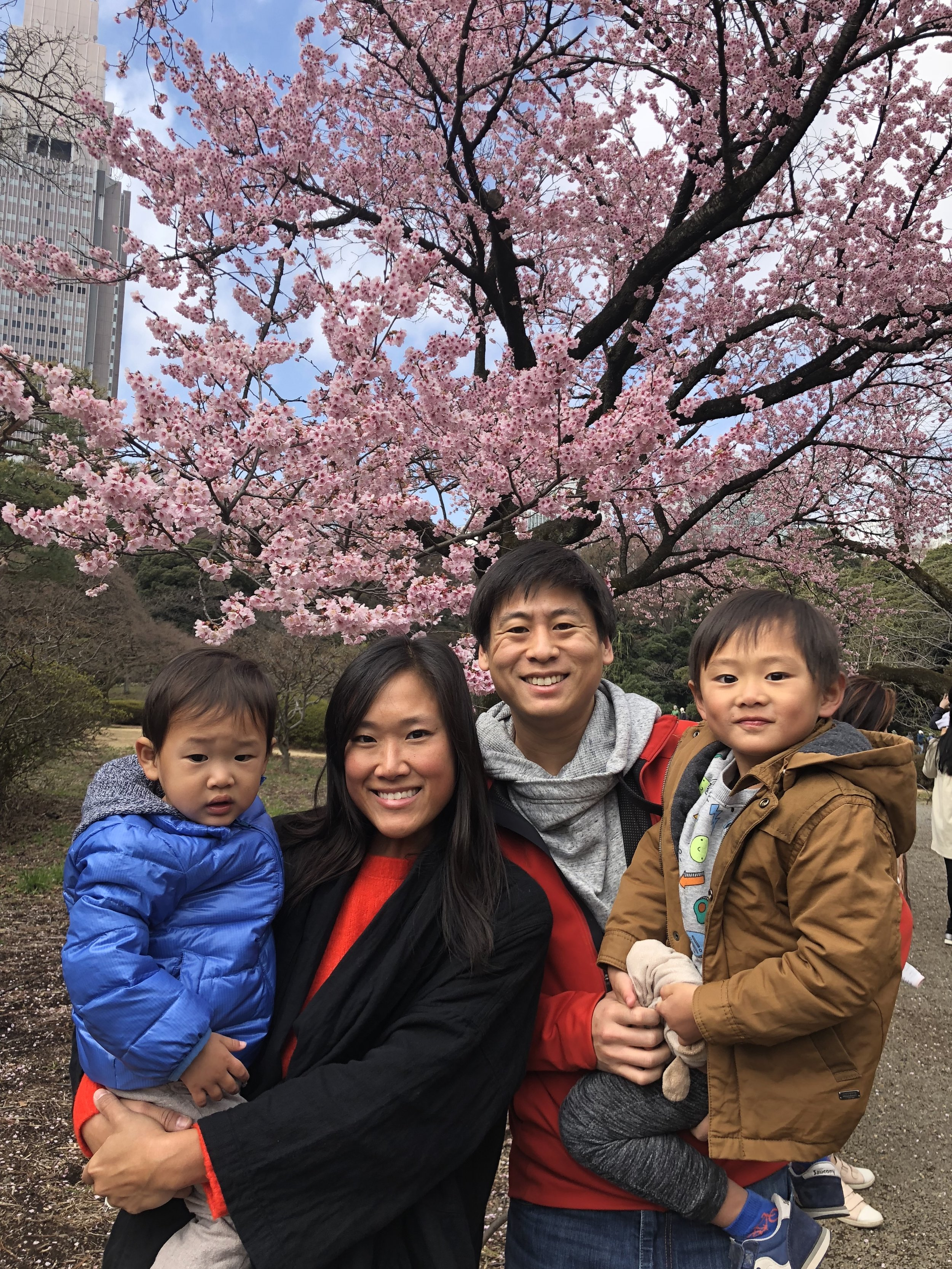 Nailed it: The Tsous get a mandatory shot in front of the cherry blossoms in central Tokyo.