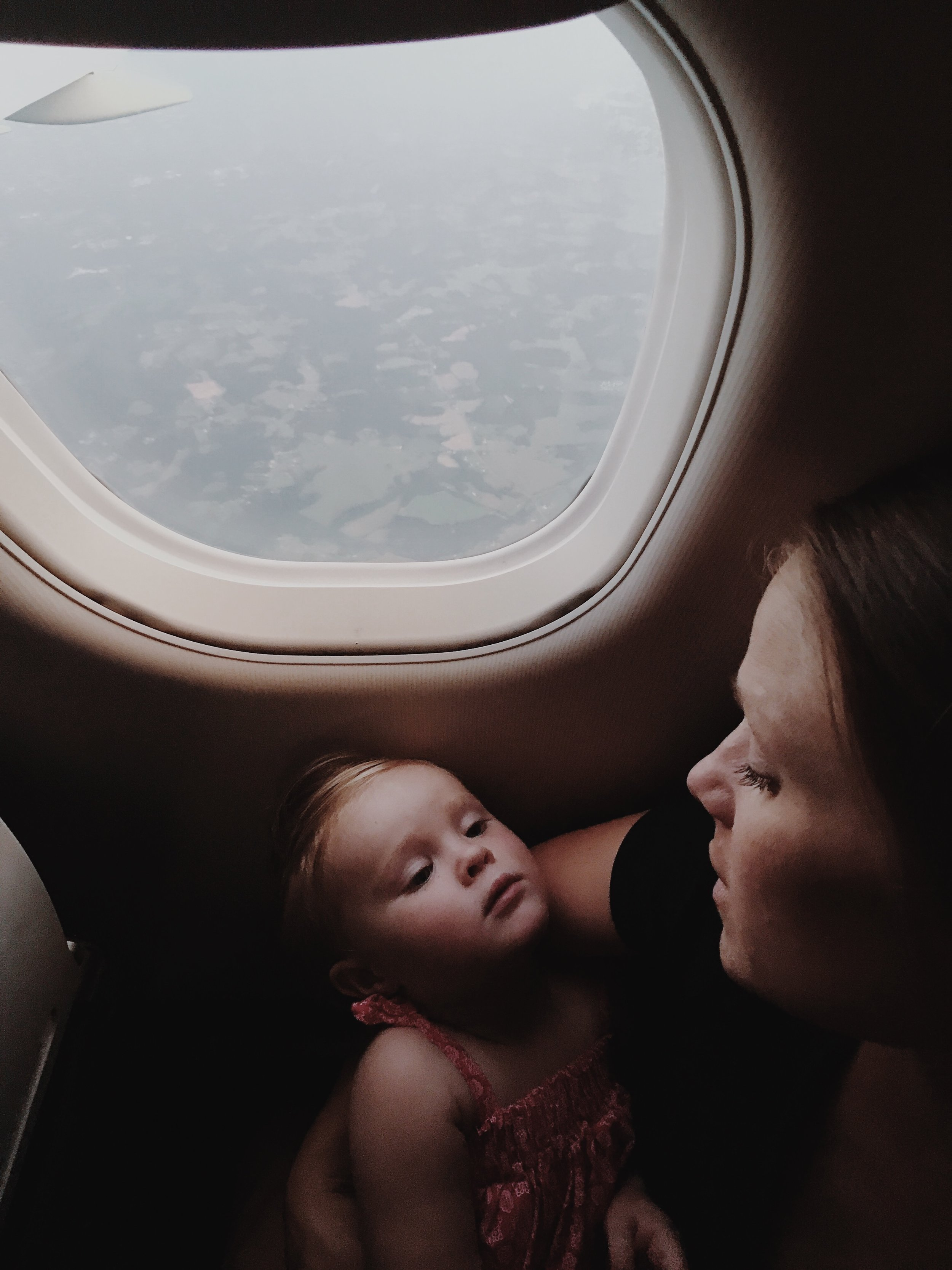 """Beauty in the everyday moments:  Here, Patrick Kolts captured his wife and daughter flying from Indiana to New York City. """"Look for the light,"""" he says. """"I loved incorporating the window and view in this picture."""""""
