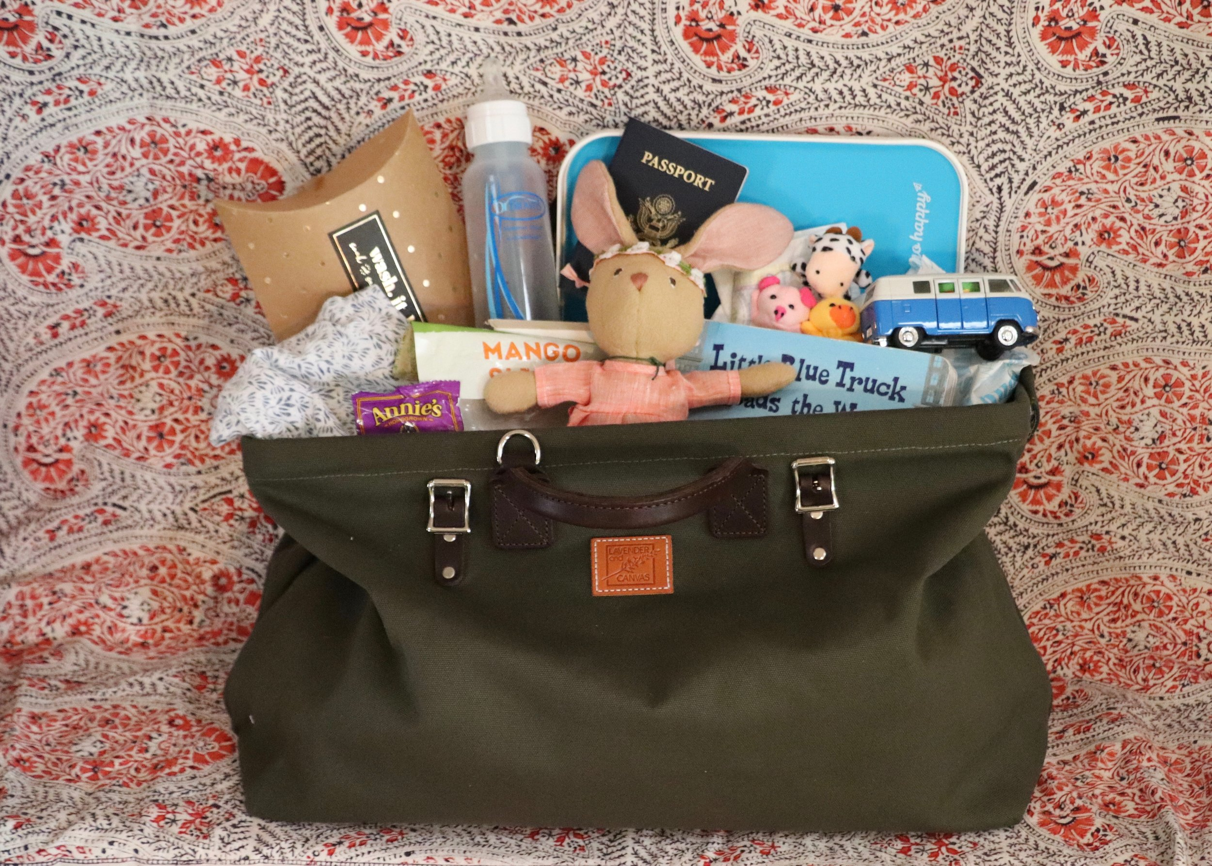The Carpenter Bag by Lavender and Canvas  : You won't believe the amount of hot (mom) mess you can squirrel away in here.
