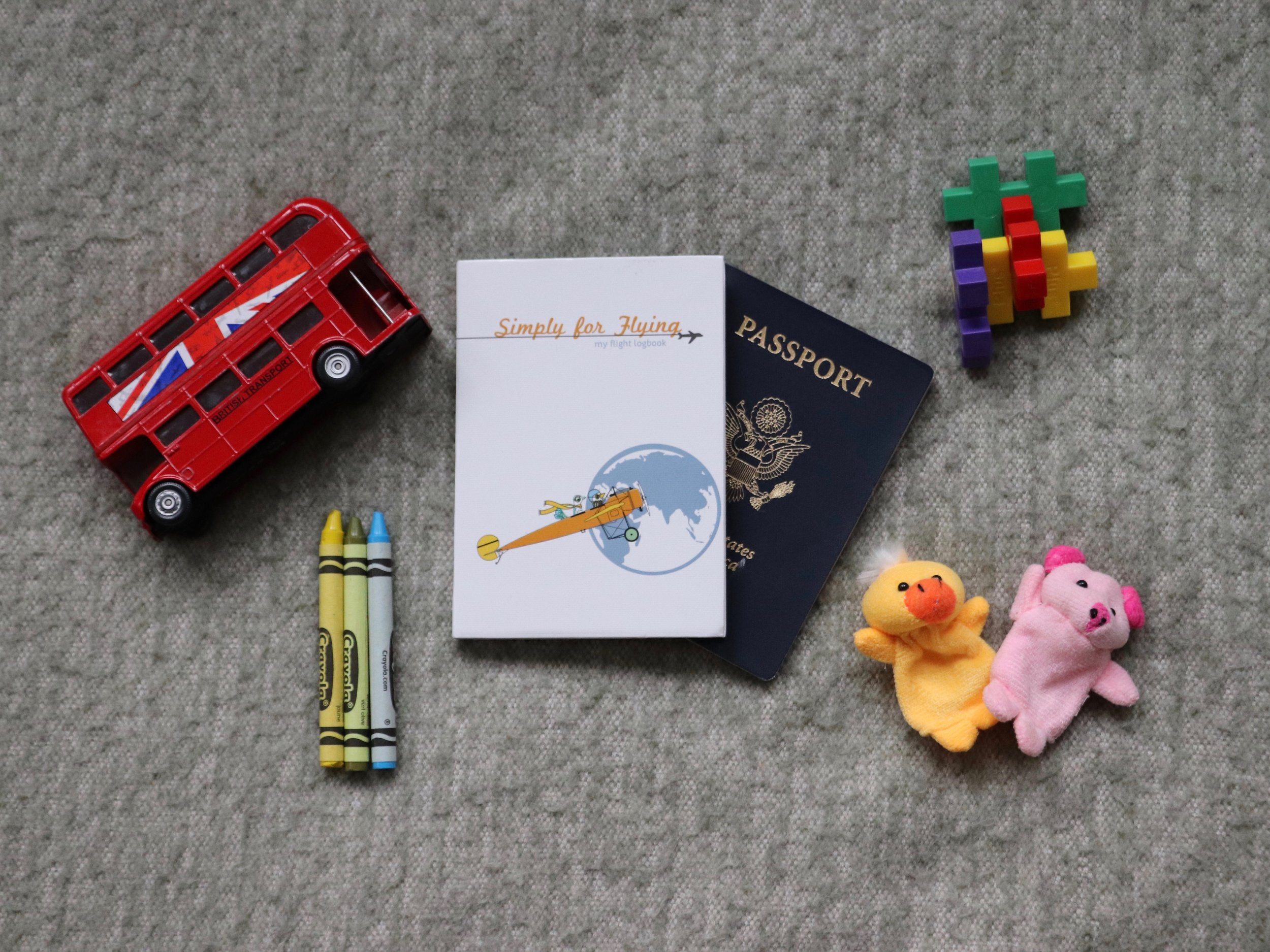 The Simply for Flying Logbook   :  Passport? Check. Finger puppets? Check. Logbook and a chance at business class? Check and check.