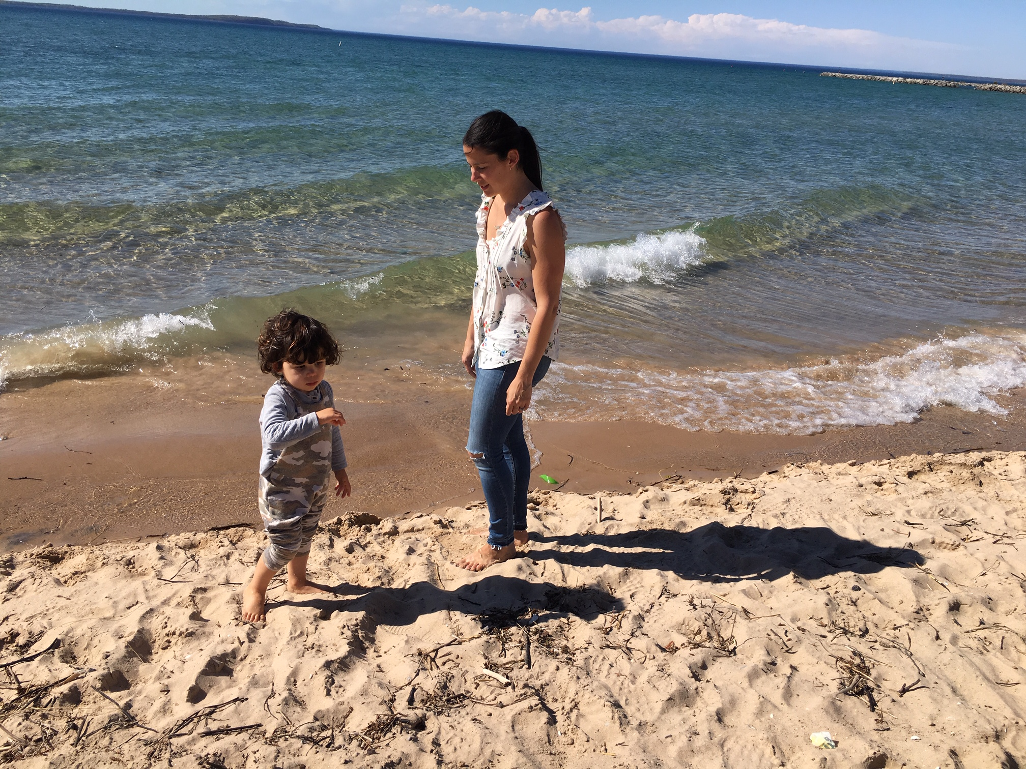 Stretch your legs:  Sarah and Kitson take a car break on the shores of Lake Michigan in Traverse City.