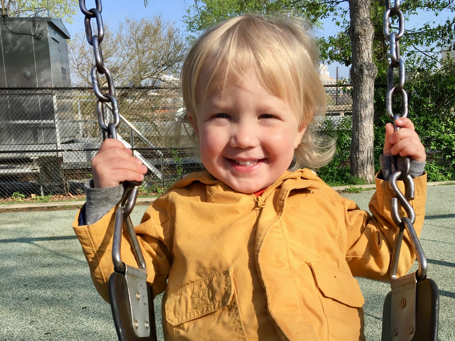 Toot Toot:  Fitz hits the swings in Schuylkill River Park, where kiddos can tackle the playground, explore gardens, and watch passing trains that often honk for their eager audience.
