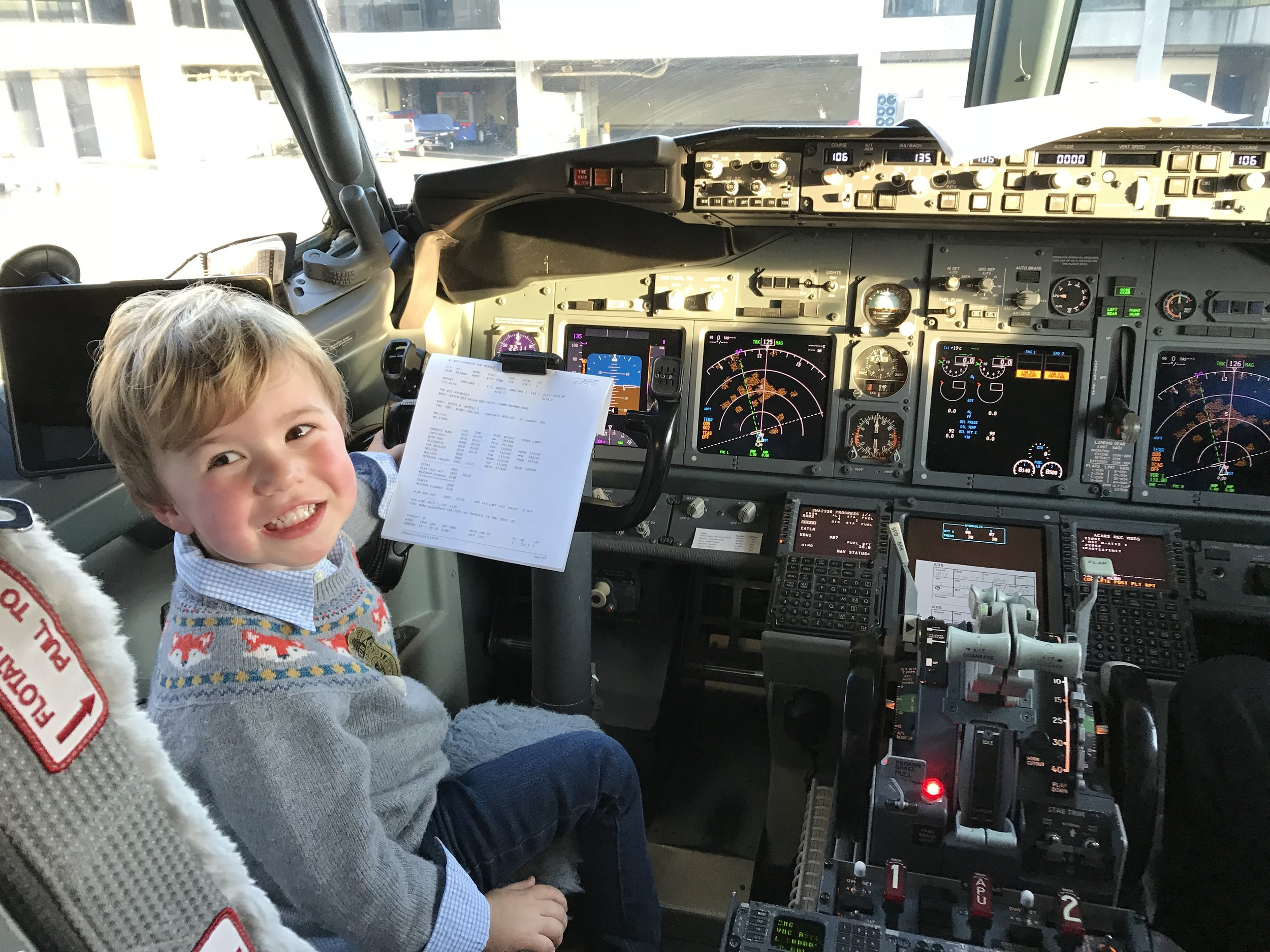 "Future pilot! "" There are so many cool things about my job,"" says pilot Mark Swartz, ""but my favorite is when kids come up and say hi during the boarding process."""