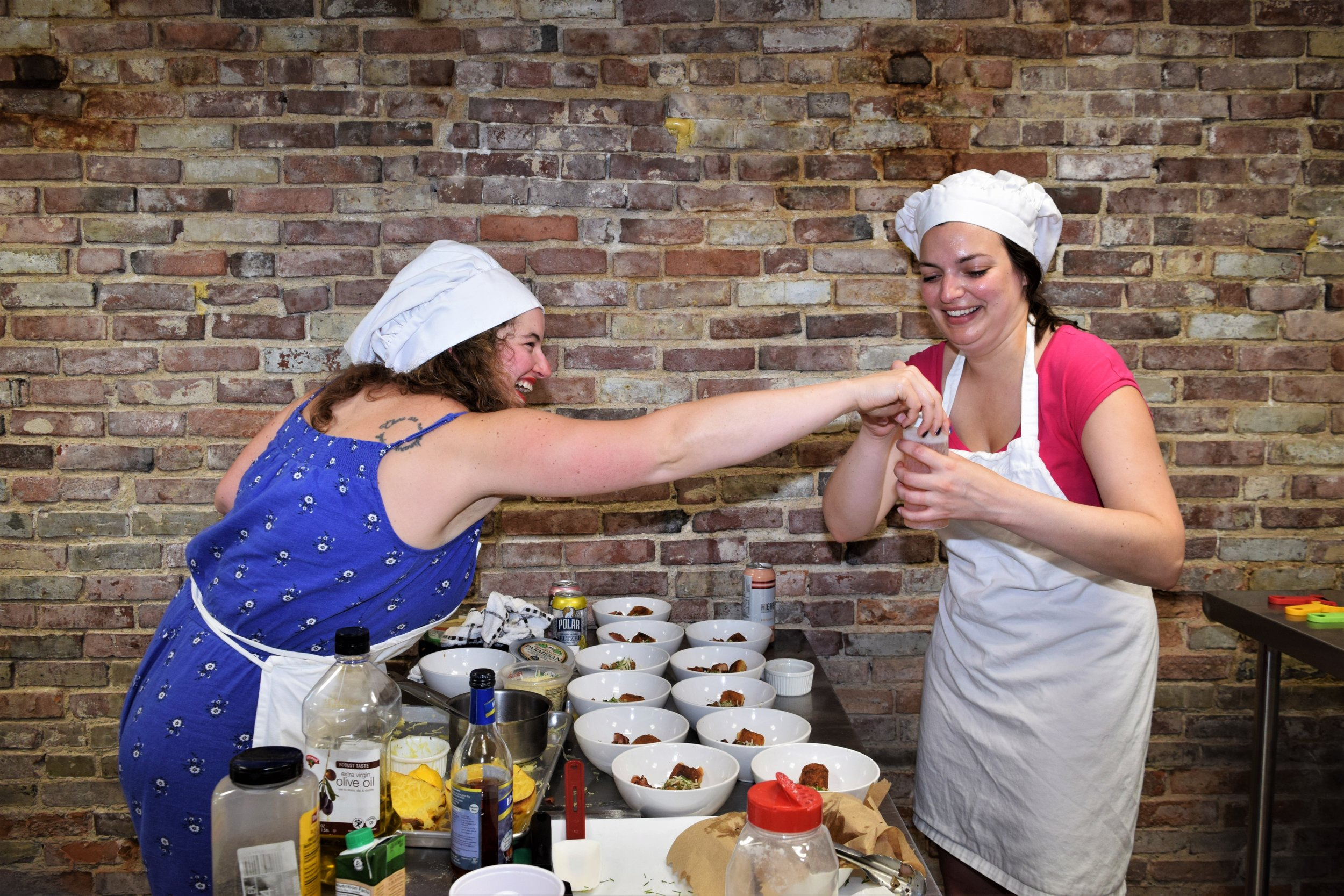 Bachelorette cooking competition teammates plating sauce together