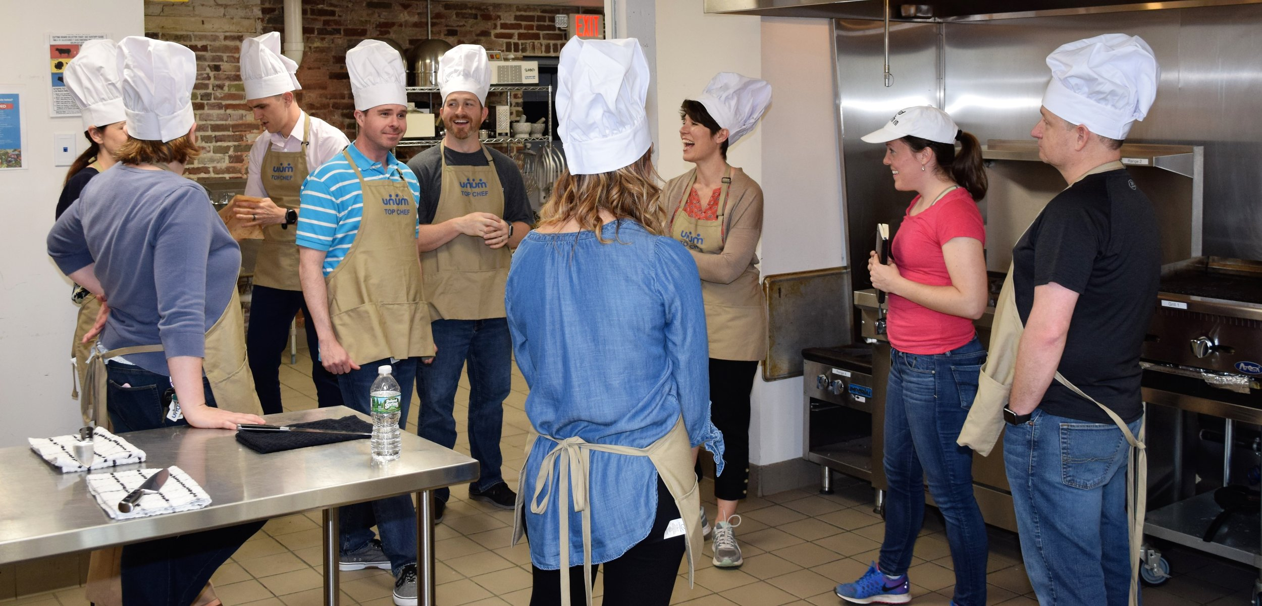 Team building group laughing before cooking competition