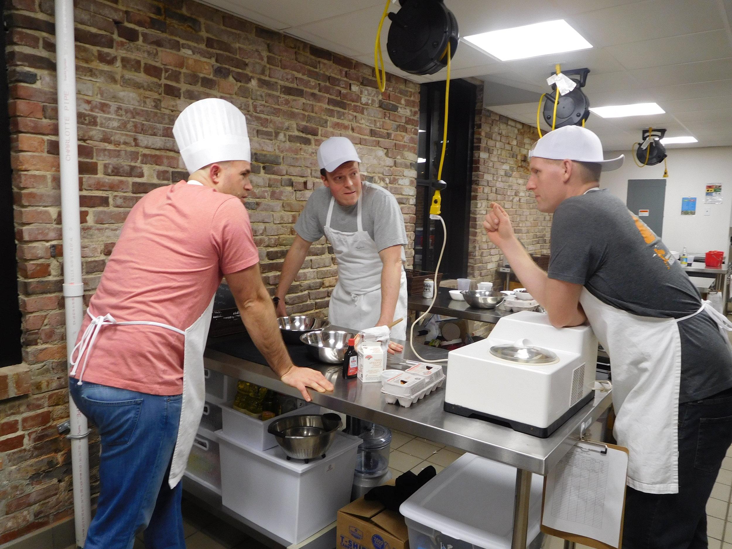 Amateur cooks brainstorming with ice cream machine