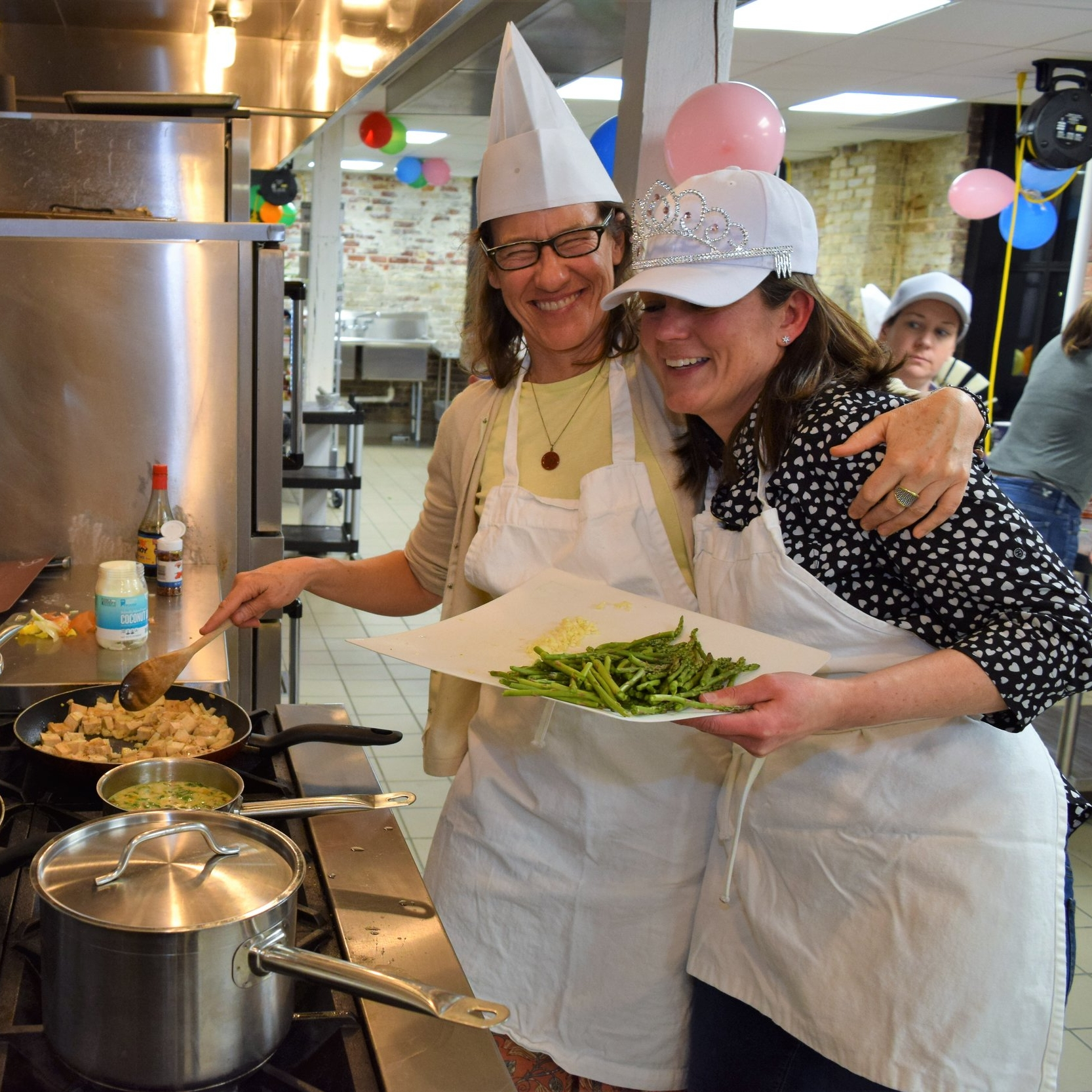 Friends cook together at fun adult birthday party competition