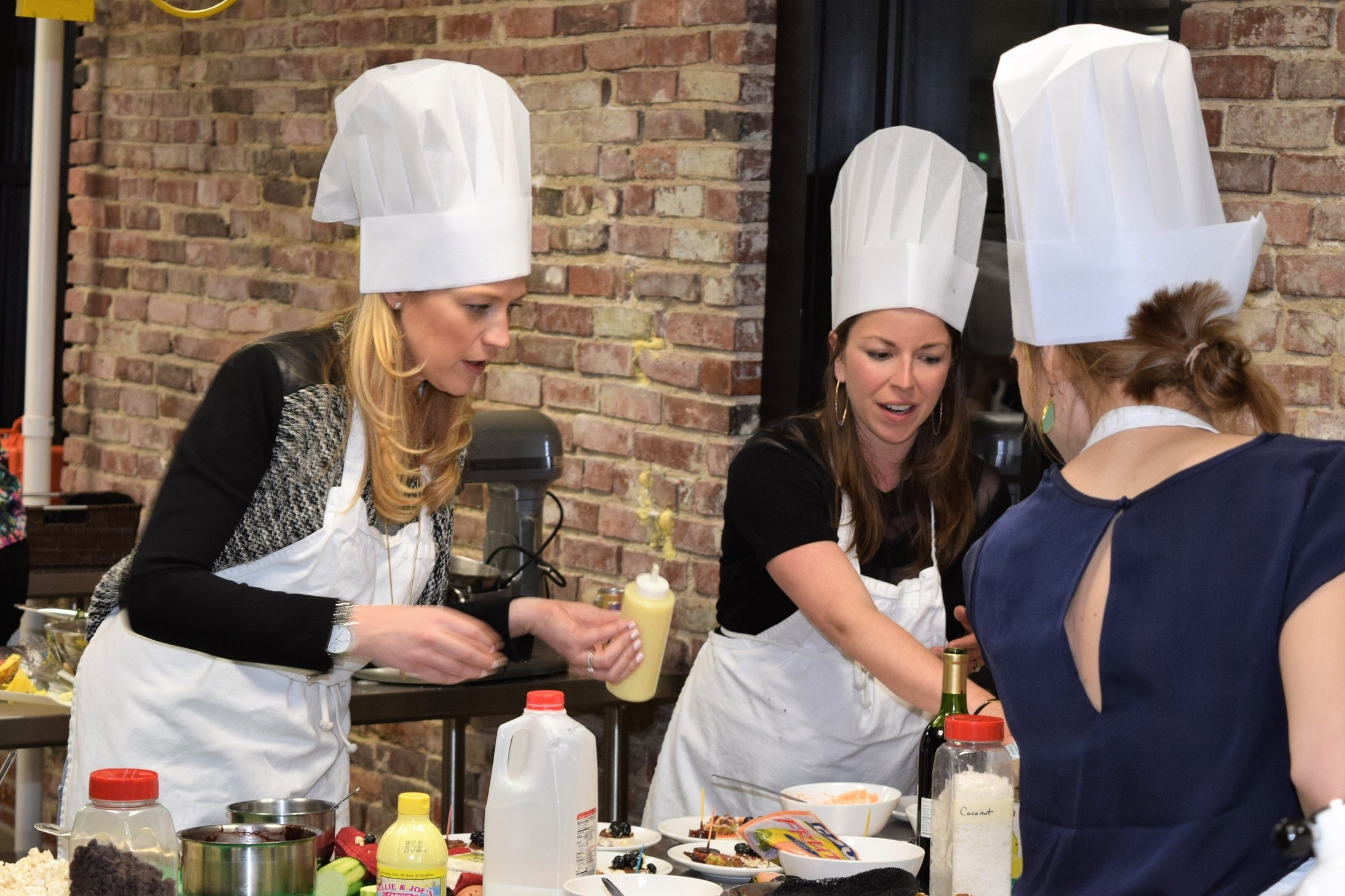Bachelorettes work together at fun and creative cooking challenge party