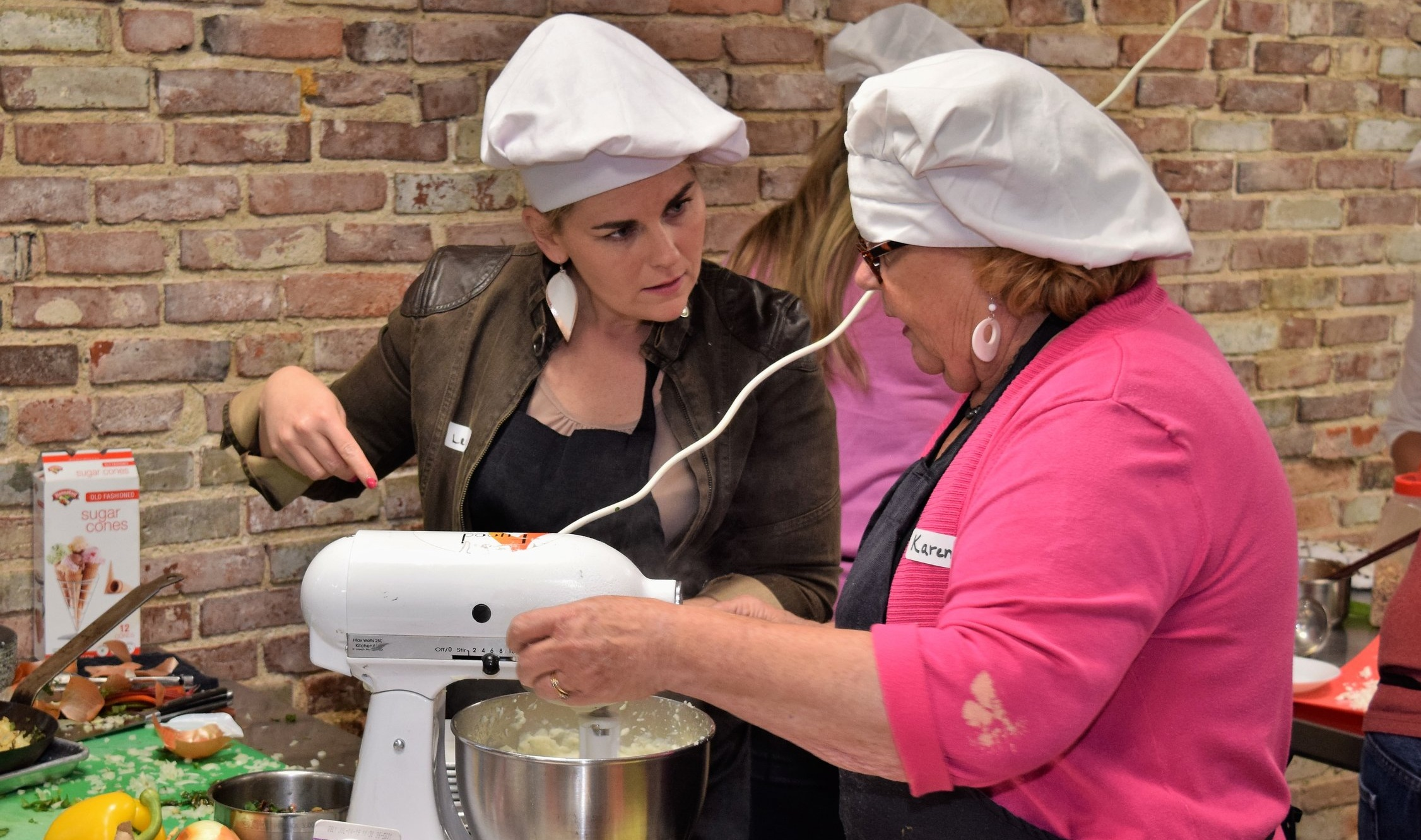 Lea and Karen of  Top-Chopped  testing and discussing their Team's mashed potatoes
