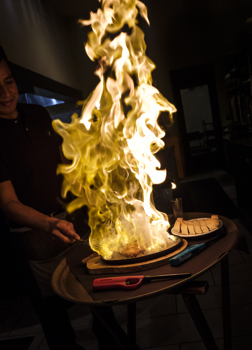 Inferno – Pan Sautéed Gruyere cheese, flambéed table side with Brandy