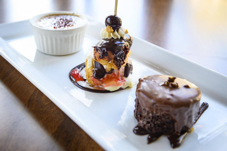 TRIO dessert plate – Crème brulee, Guittard Chocolate Cake, Mini banana split eclair