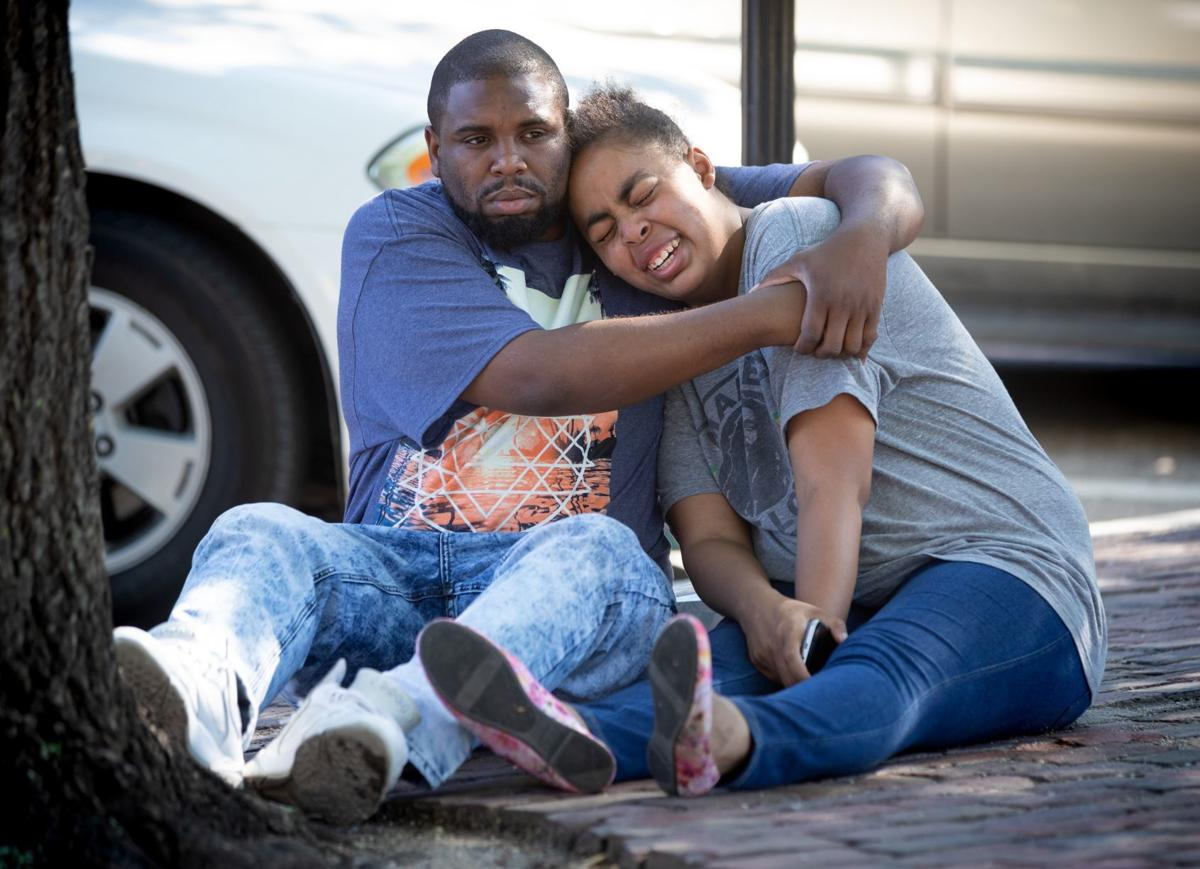 Vanessa Wesson, Jasmine Harris' older sister, is comforted by cousin DeShawn Alford.  Kent Sievers/Omaha World-Herald