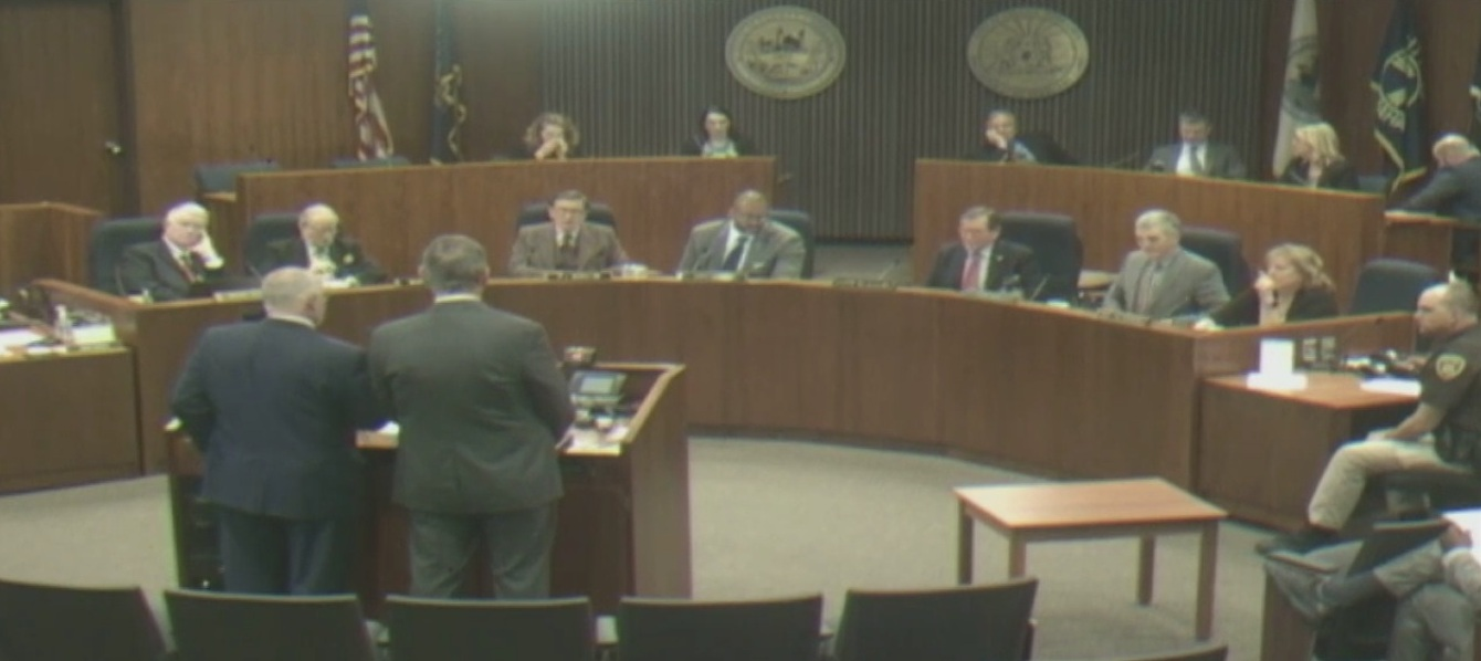 Commissioners meet in legislative chambers at the Civic Center, set up in a semi-circle.