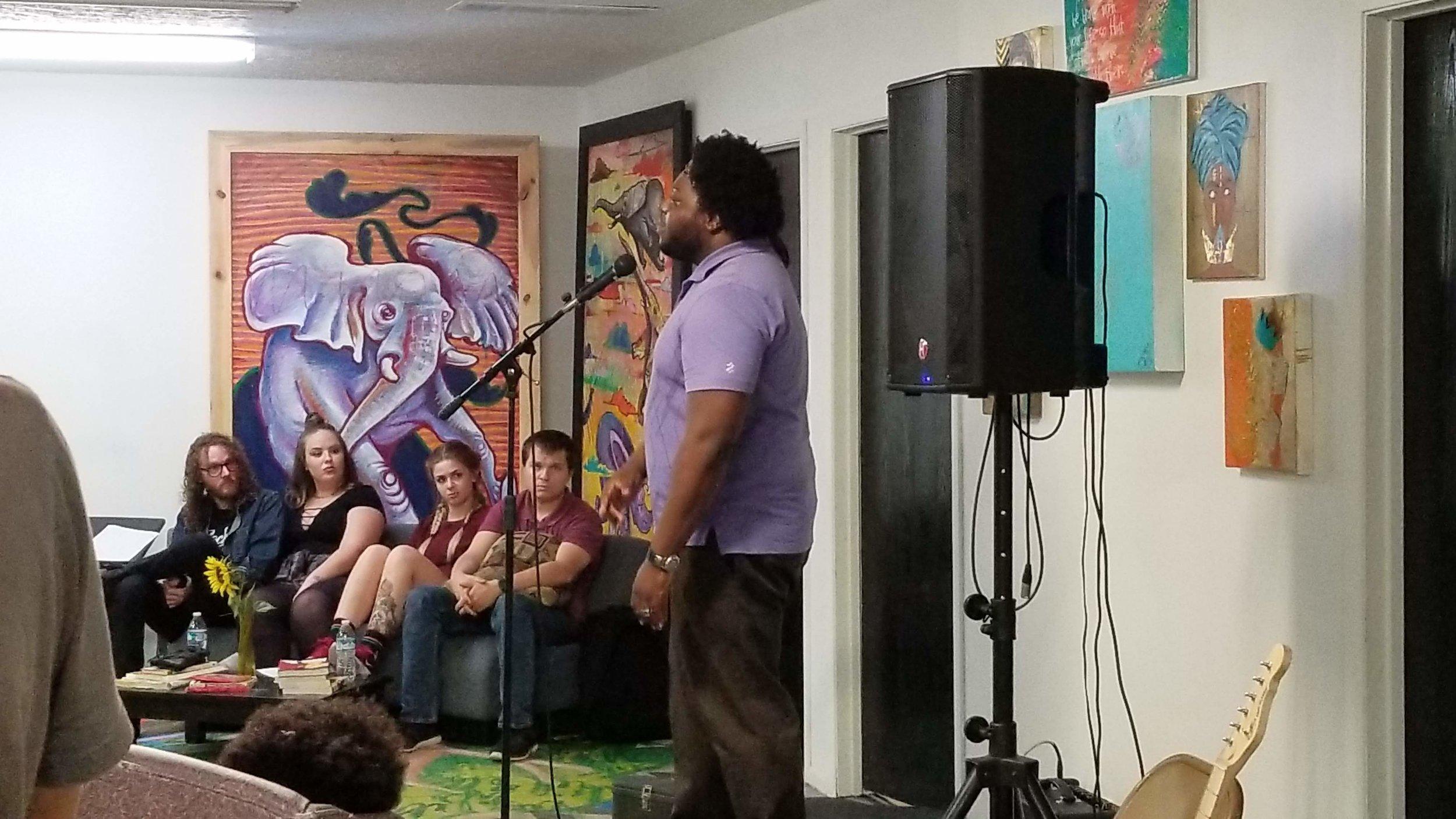 Poet performing at Culxr House
