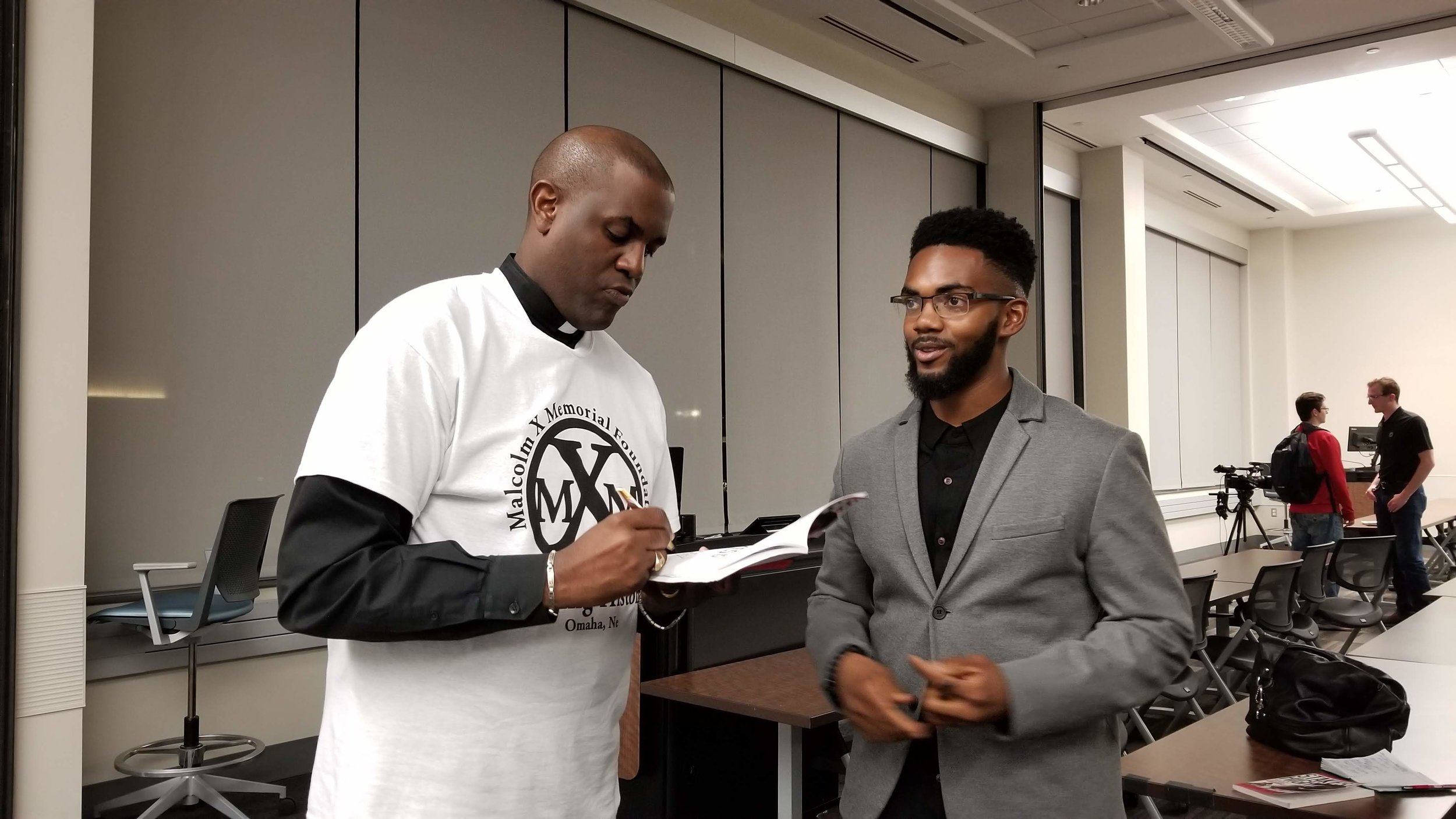 Dr. Rev. Waters and UNO Student Body Vice-President Jabin Moore
