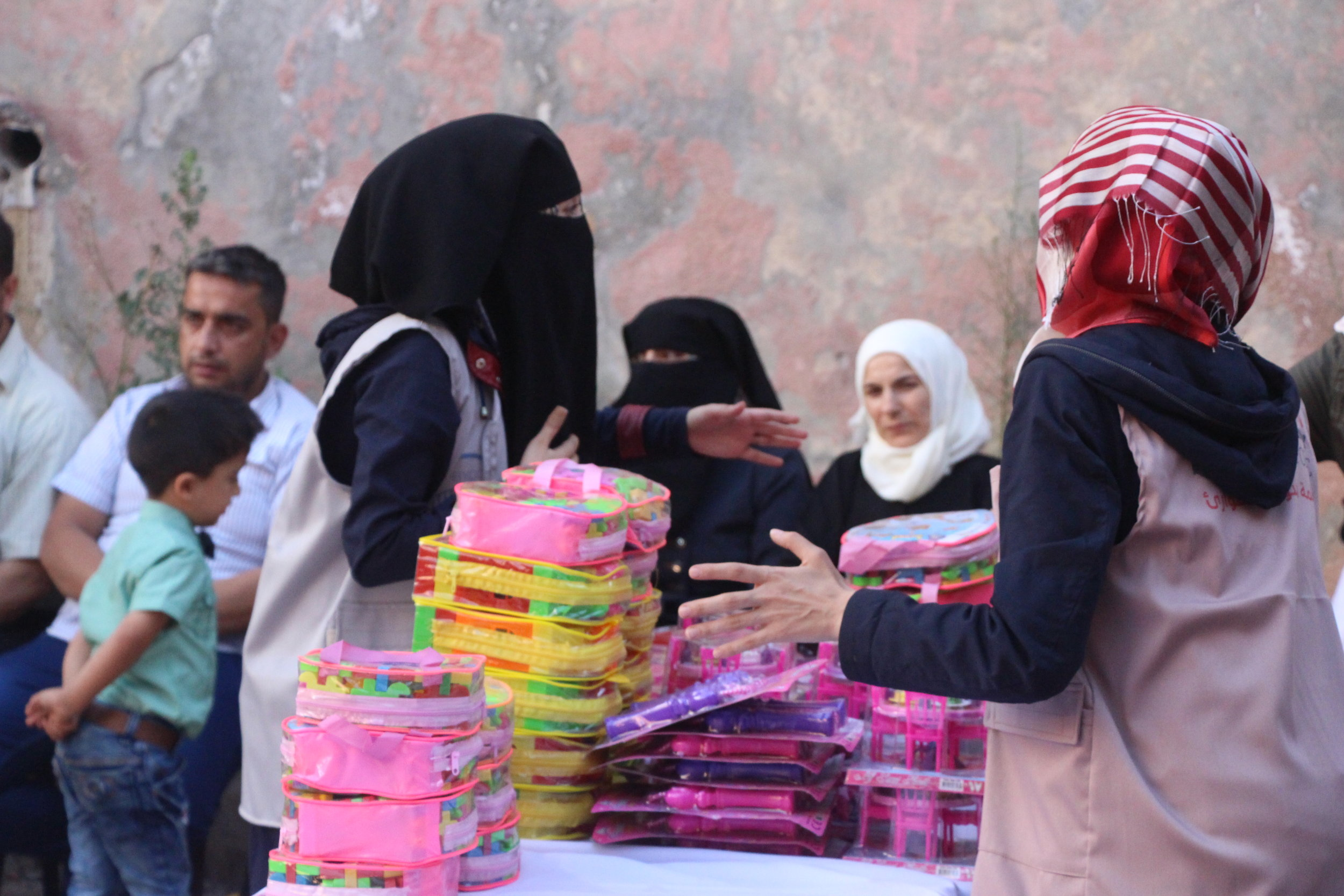 G ifts and Food for all!   At the Eid celebration, gifts and toys were given to each child- one of the most exciting joys of the holiday!  SETF also provided families with enough meat to last an entire month. 14 lambs and one cow provide nourishment to hundreds of families in Idlib.